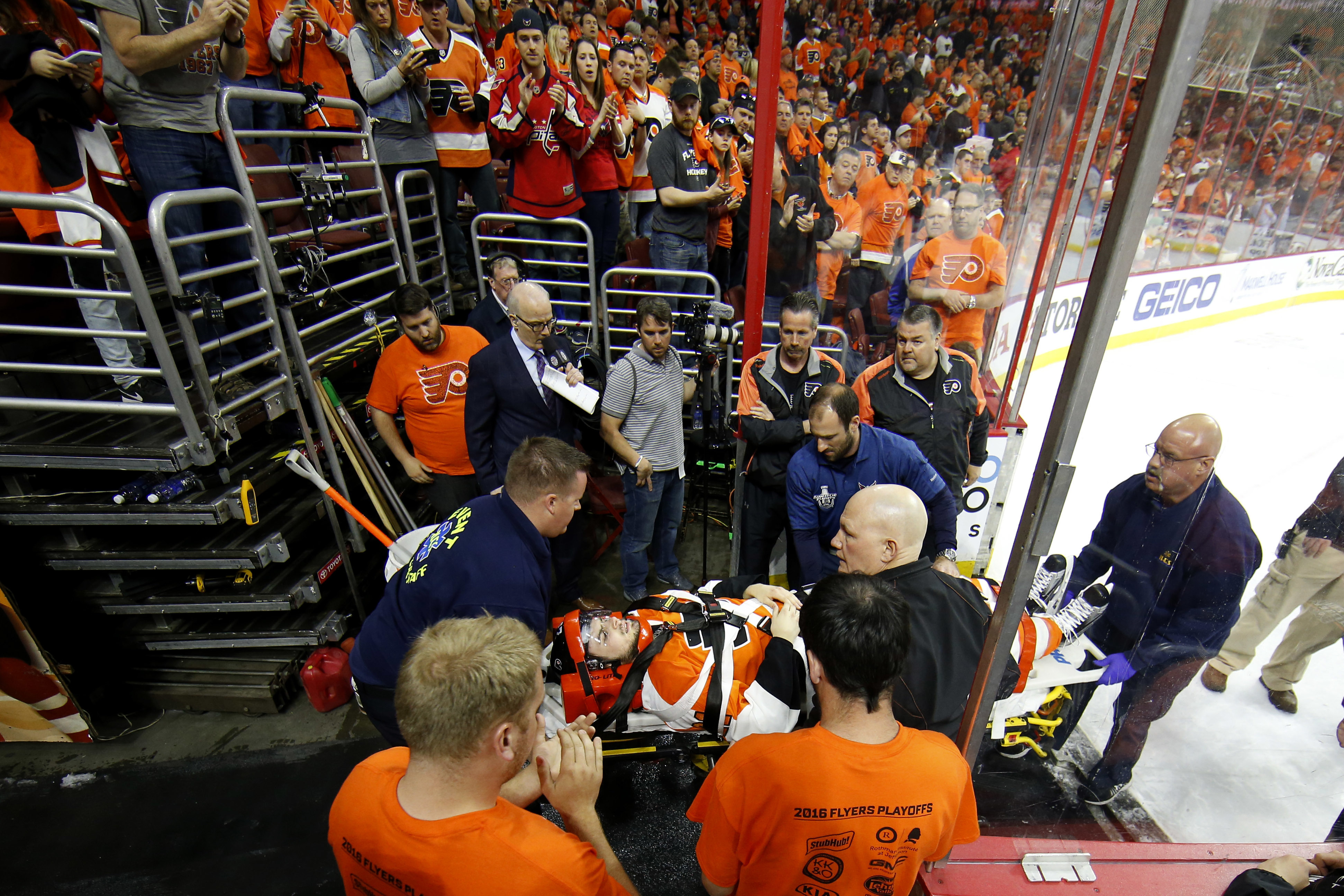 Philadelphia Flyers' Scott Laughton is transported off the ice after an injury during the first period of Game 4 in the first round of the NHL Stanley Cup hockey playoffs against the Washington Capitals , Wednesday, April 20, 2016, in Philadelphia. (AP Ph