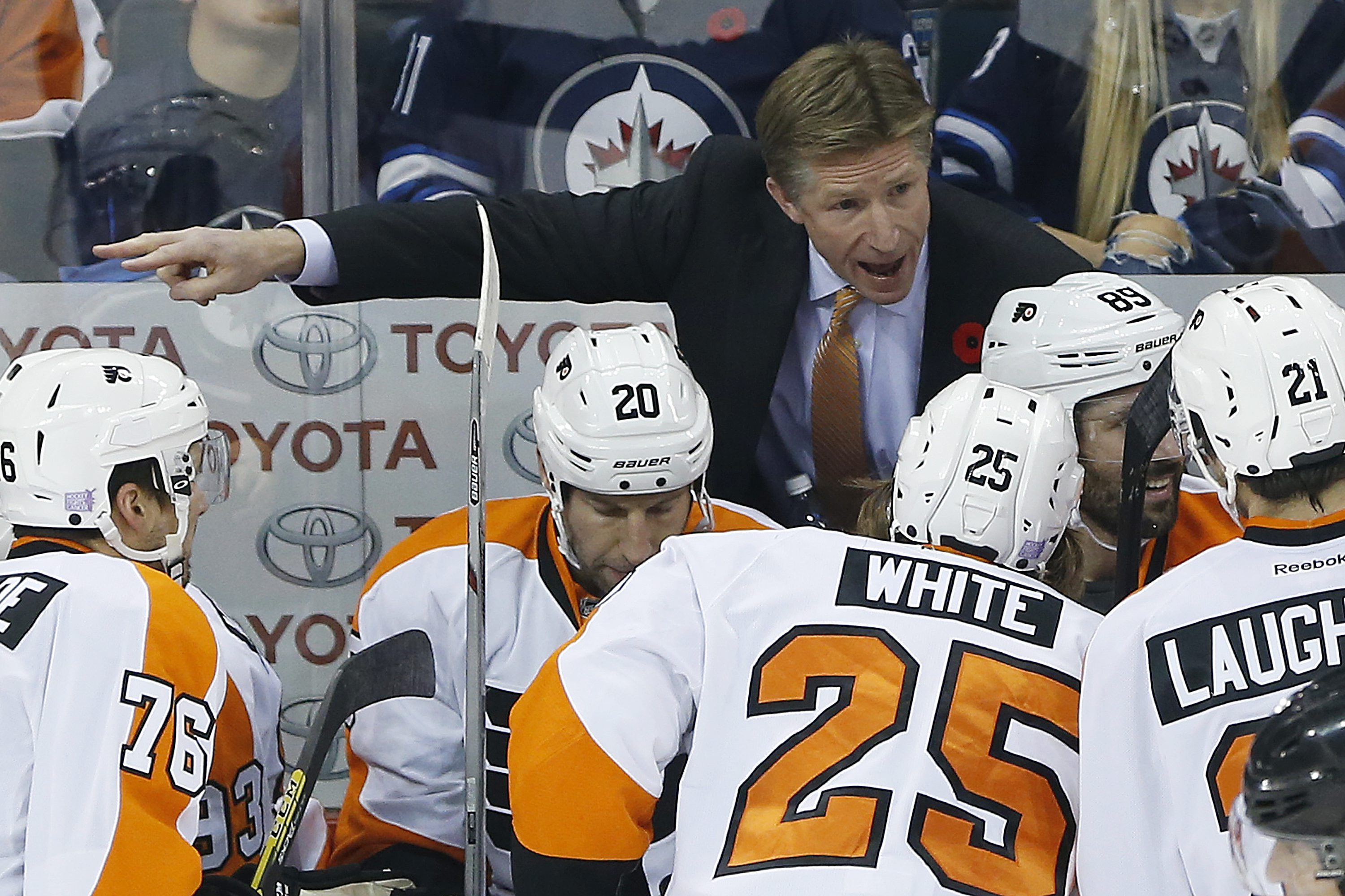 FILE - In this Nov. 7, 2015, file photo, Philadelphia Flyers head coach Dave Hakstol,top, speaks to his players during the first period of NHL hockey game against the Winnipeg Jets in Winnipeg, Manitoba. Last summer Hakstol became the first college hockey