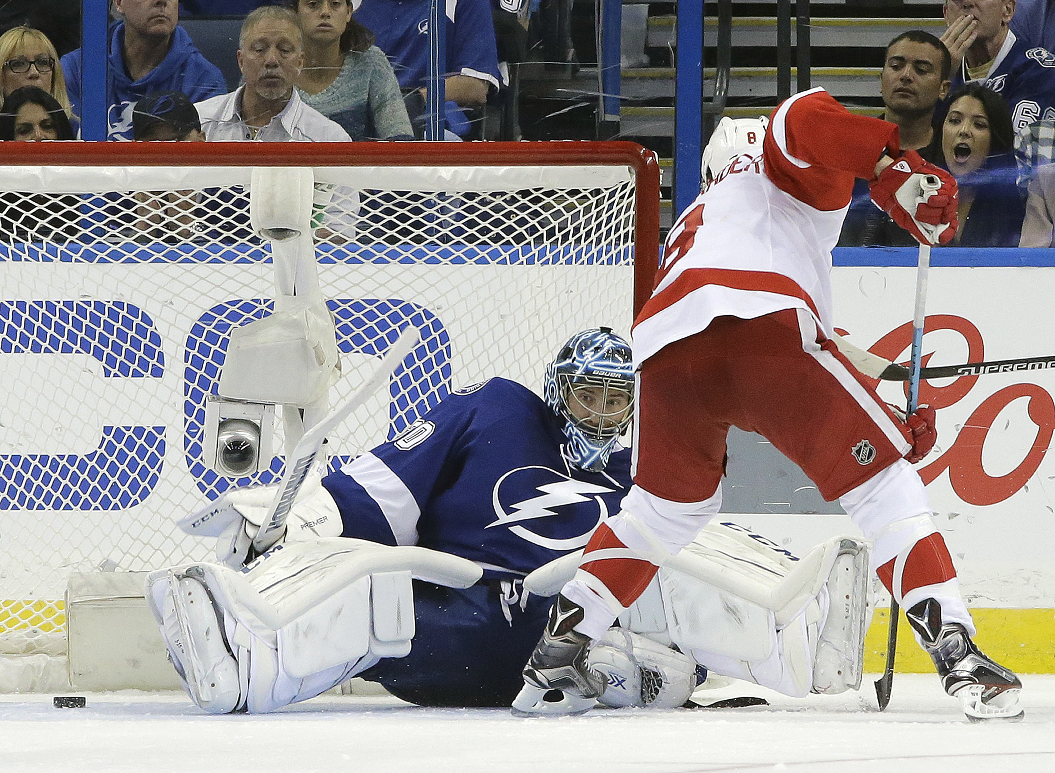 Tampa Bay Lightning goalie Ben Bishop (30) makes a save on a shot by Detroit Red Wings left wing Justin Abdelkader (8) during the second period of Game 5 in a first-round NHL hockey Stanley Cup playoff series Thursday, April 21, 2016, in Tampa, Fla. (AP P