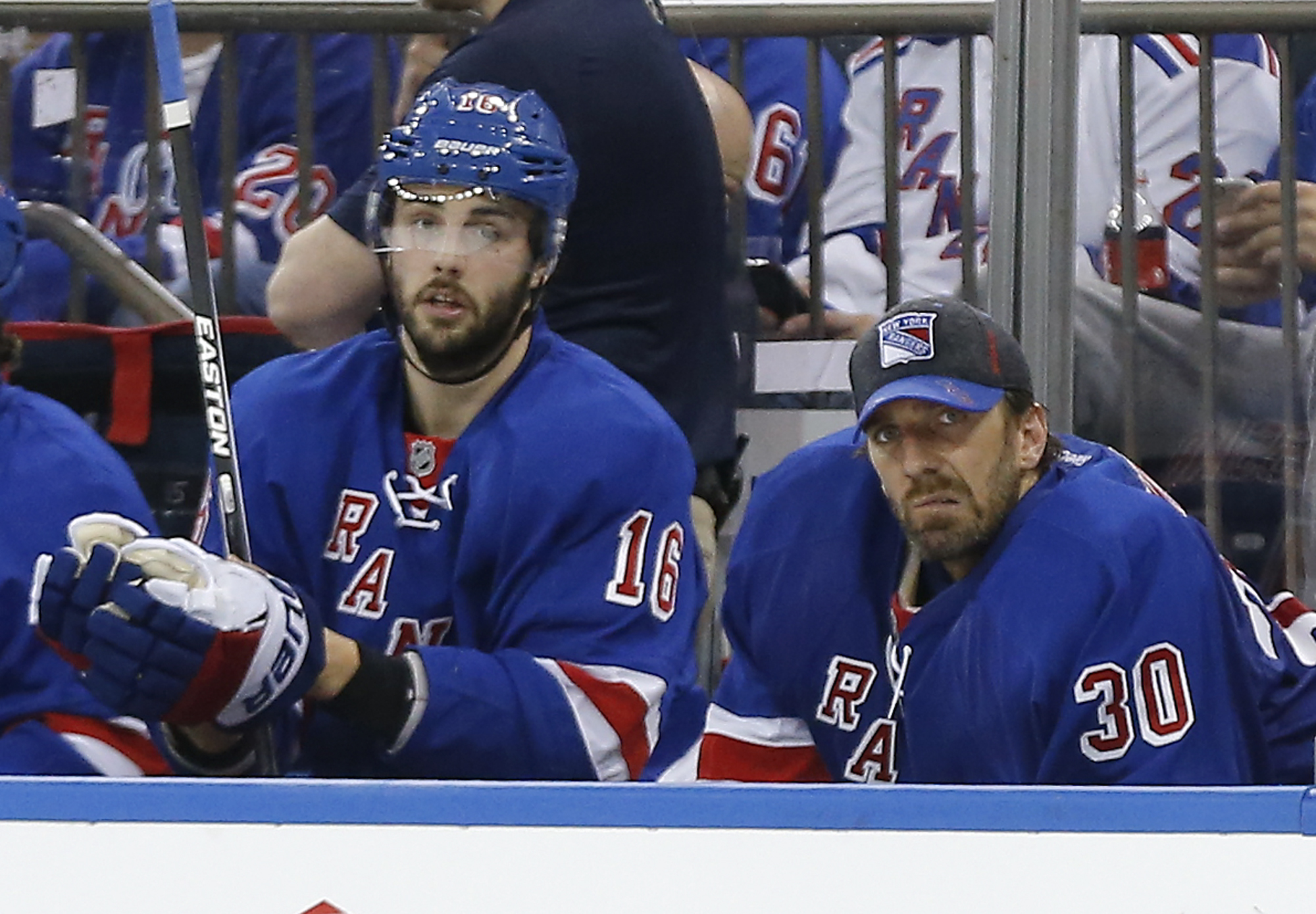 New York Rangers goalie Henrik Lundqvist (30) watches from the bench alongside center Derick Brassard (16) during the second period after giving up four goals to the Pittsburgh Penguins in Game 4 of an NHL hockey first-round Stanley Cup playoff series, Th