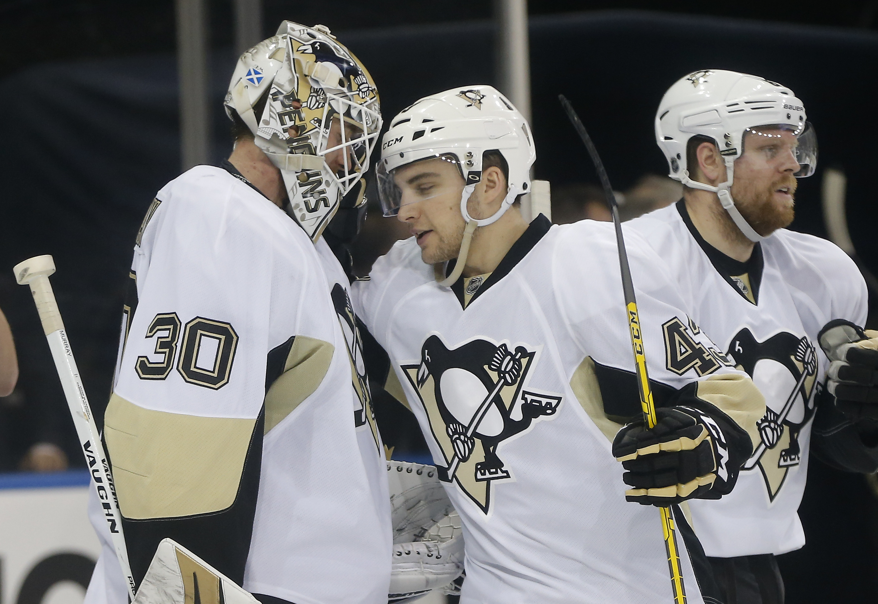 Pittsburgh Penguins goalie Matt Murray (30) is congratulated by left wing Conor Sheary (43) after recording a shutout in the Penguins' 5-0 win over the New York Rangers in Game 4 of an NHL hockey first-round Stanley Cup playoff series, Thursday, April 21,