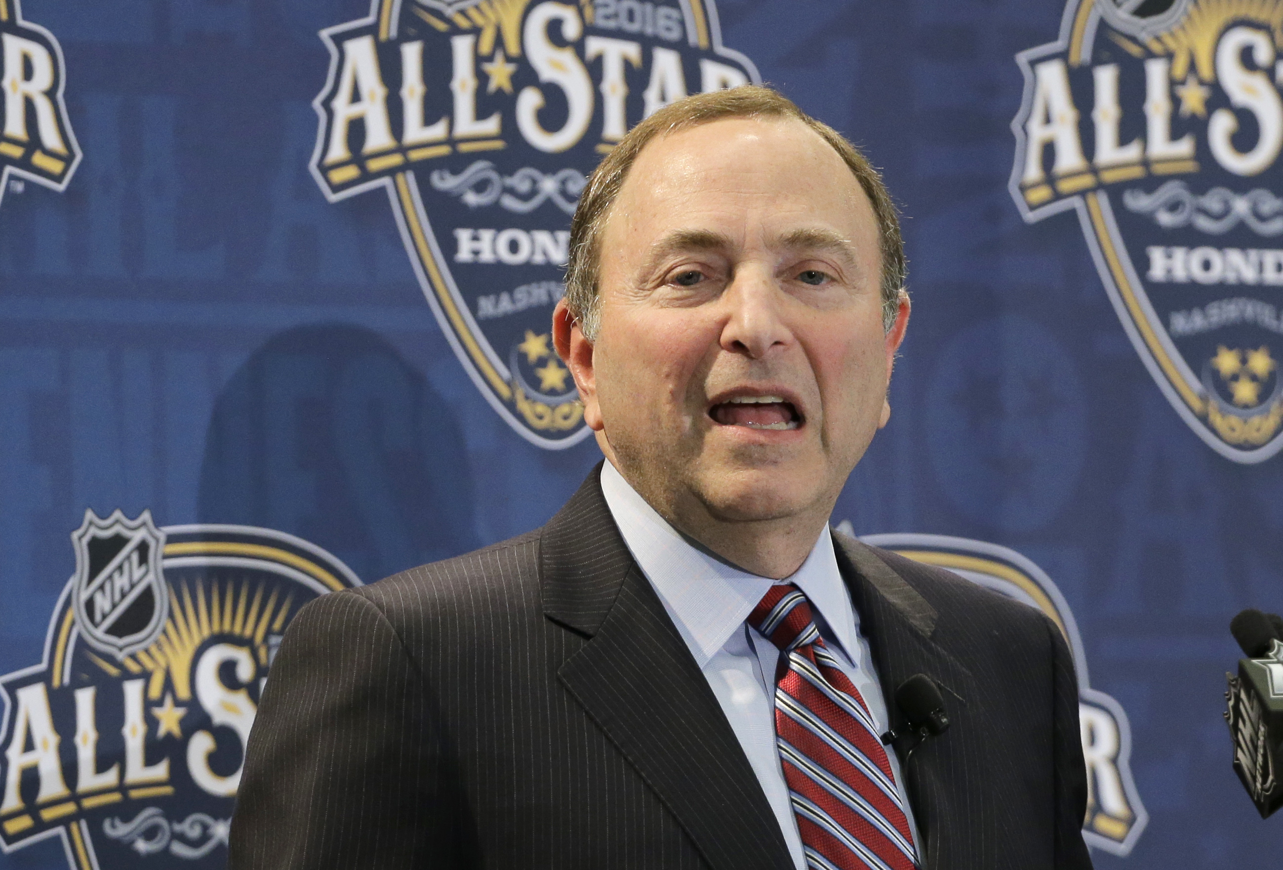 FILE - In this Jan. 31, 2016, file photo, NHL commissioner Gary Bettman speaks during a news conference before the NHL hockey All-Star game skills competition in Nashville, Tenn. Days after watching Philadelphia fans throw light-up wristbands onto the ice