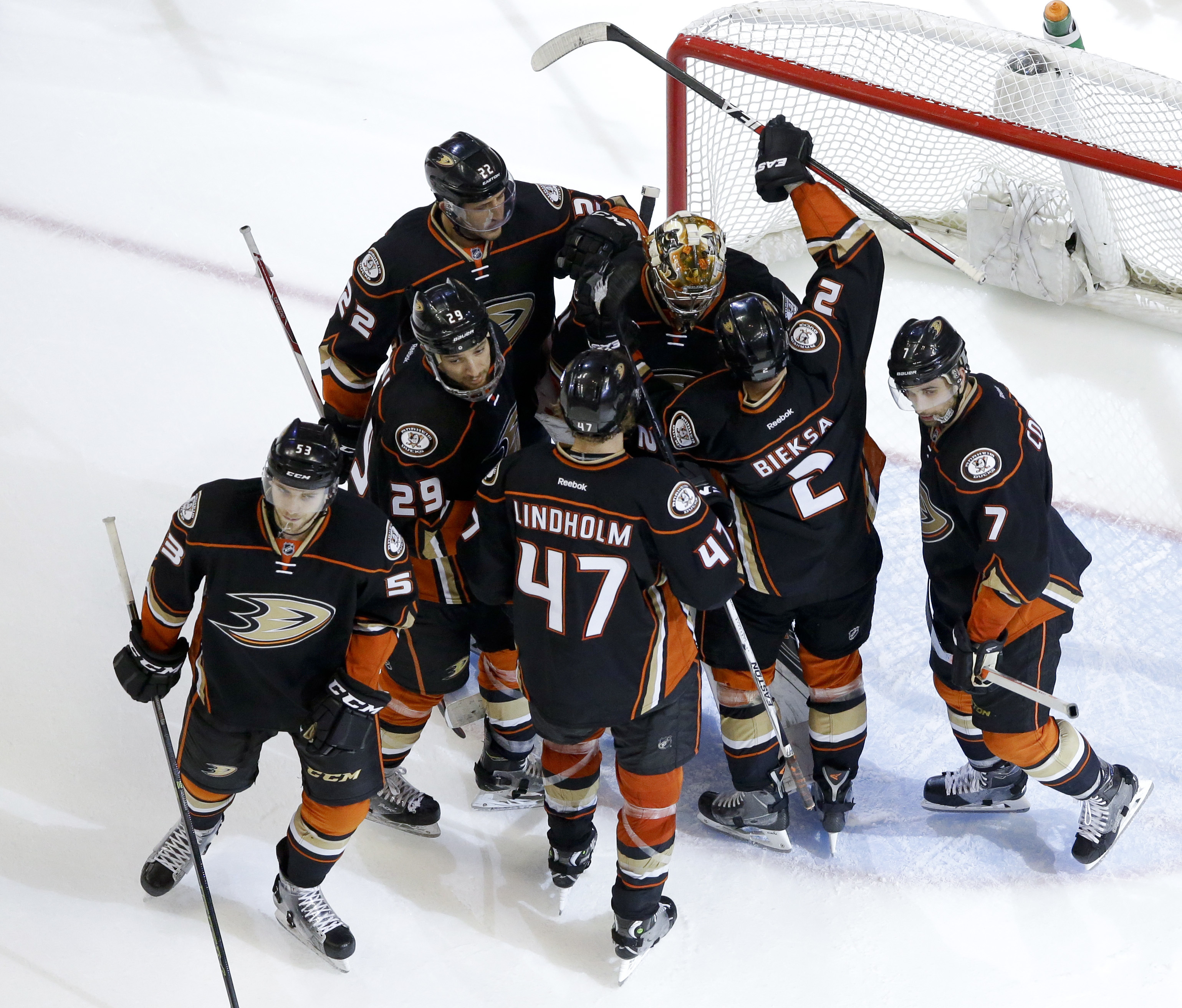 The Anaheim Ducks celebrates after a 5-2 win against the Nashville Predators during Game 5 in an NHL hockey Stanley Cup playoffs first-round series in Anaheim, Calif., Saturday, April 23, 2016. (AP Photo/Chris Carlson)