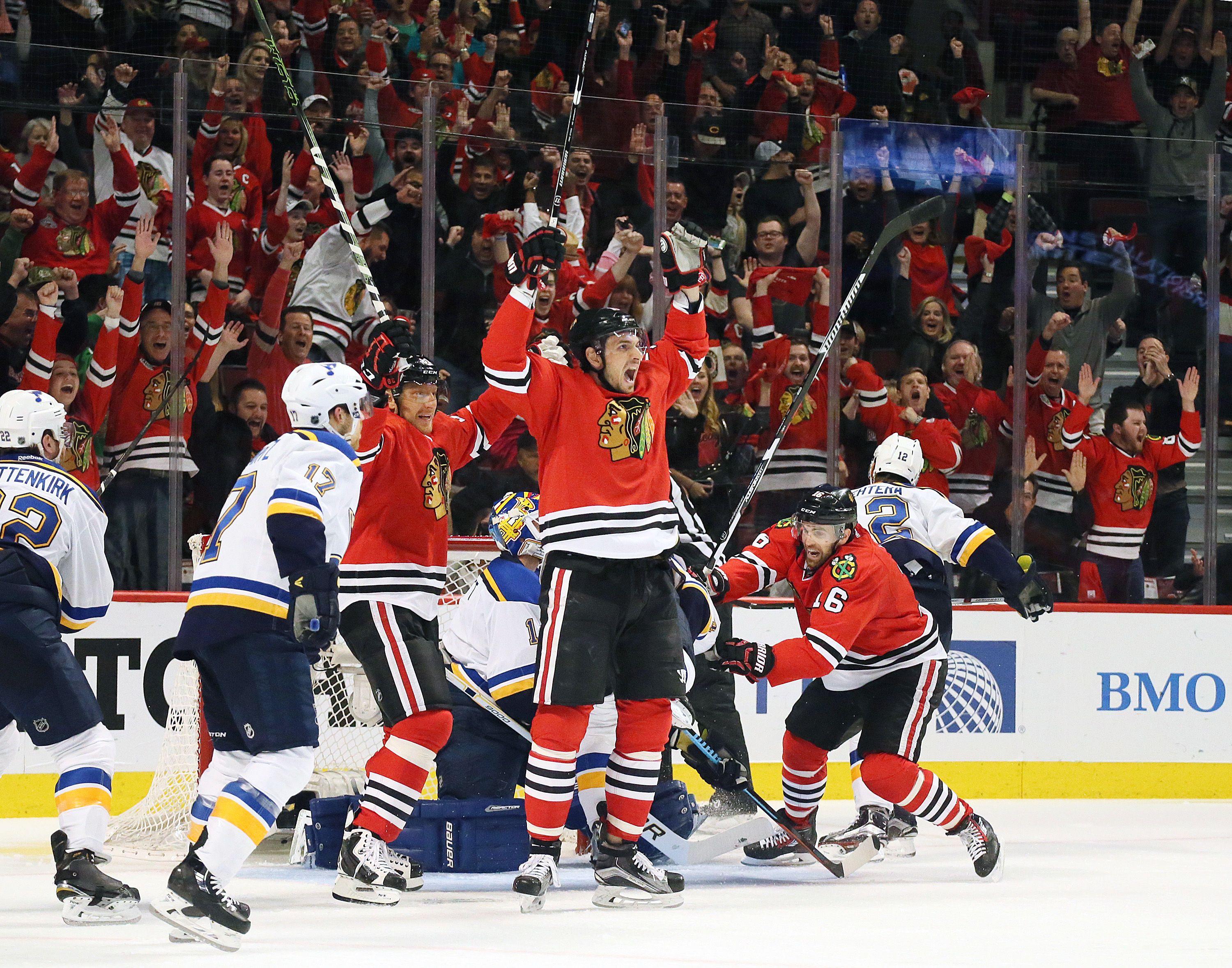 Chicago Blackhawks center Artem Anisimov, center, reacts after scoring in the second period of Game 6 of an NHL hockey first-round Stanley Cup playoff series against the St. Louis Blues, Saturday, April 23, 2016, in Chicago. (Chris Lee/St. Louis Post-Disp