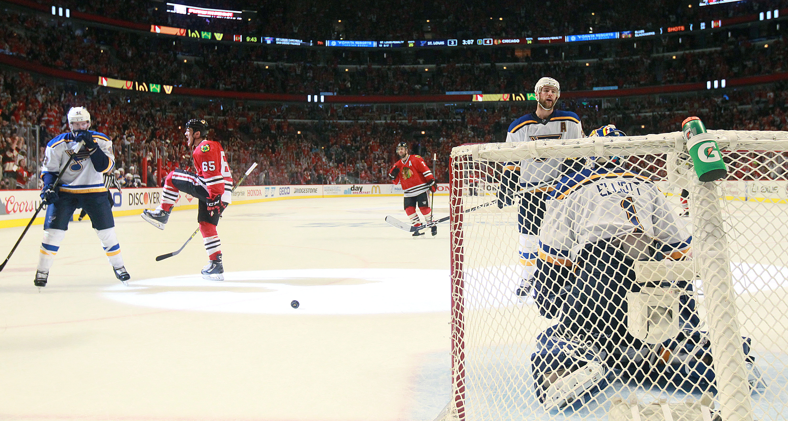 Chicago Blackhawks right wing Andrew Shaw (65) reacts after scoring in the third period against St. Louis Blues goaltender Brian Elliott (1) during Game 6 of an NHL hockey first-round Stanley Cup playoff series against the St. Louis Blues, Saturday, April