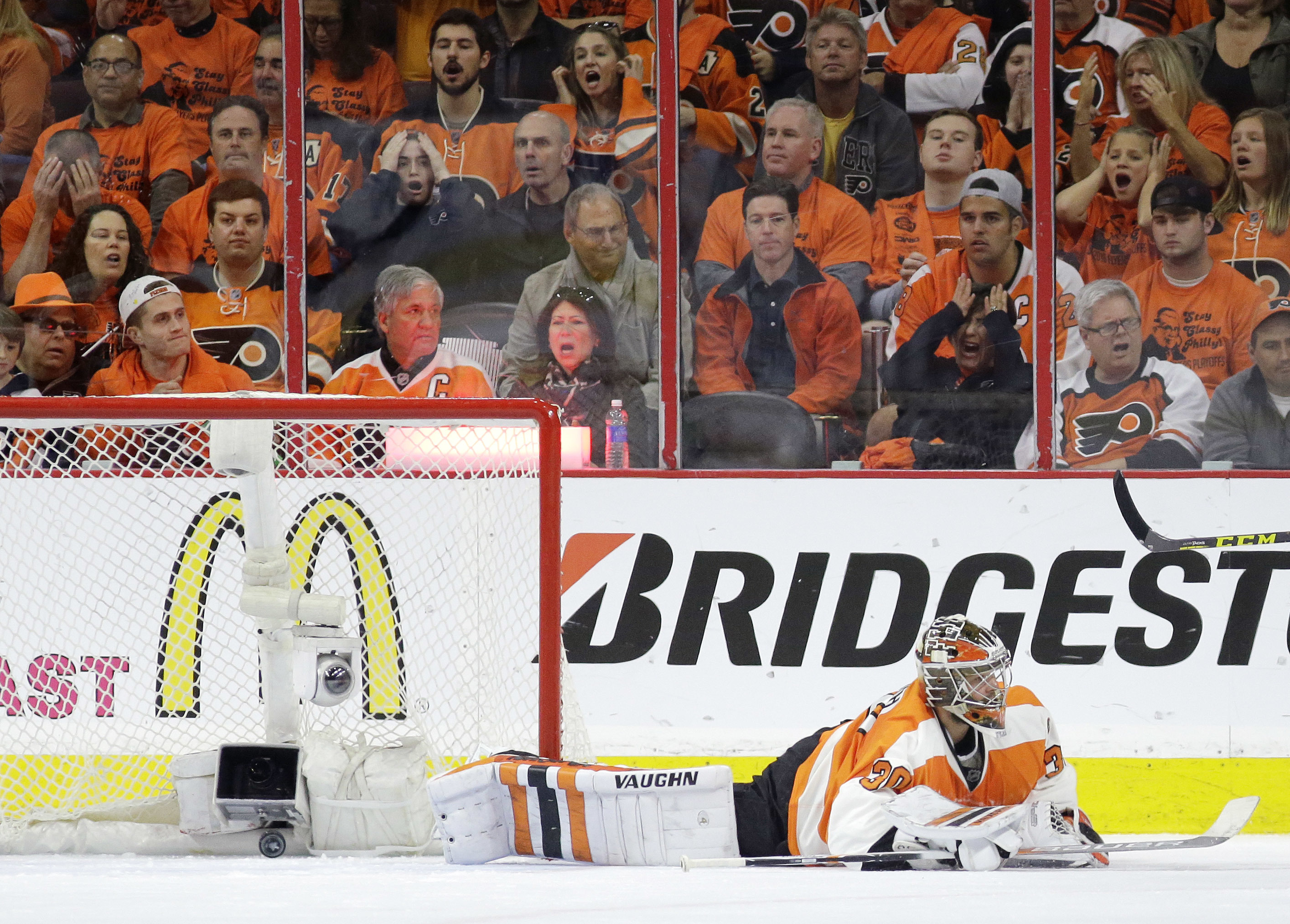Fans reacts after a goal against Philadelphia Flyers' Michal Neuvirth by Washington Capitals' Nicklas Backstrom during the second period of Game 6 in the first round of the NHL Stanley Cup hockey playoffs, Sunday, April 24, 2016, in Philadelphia. (AP Phot