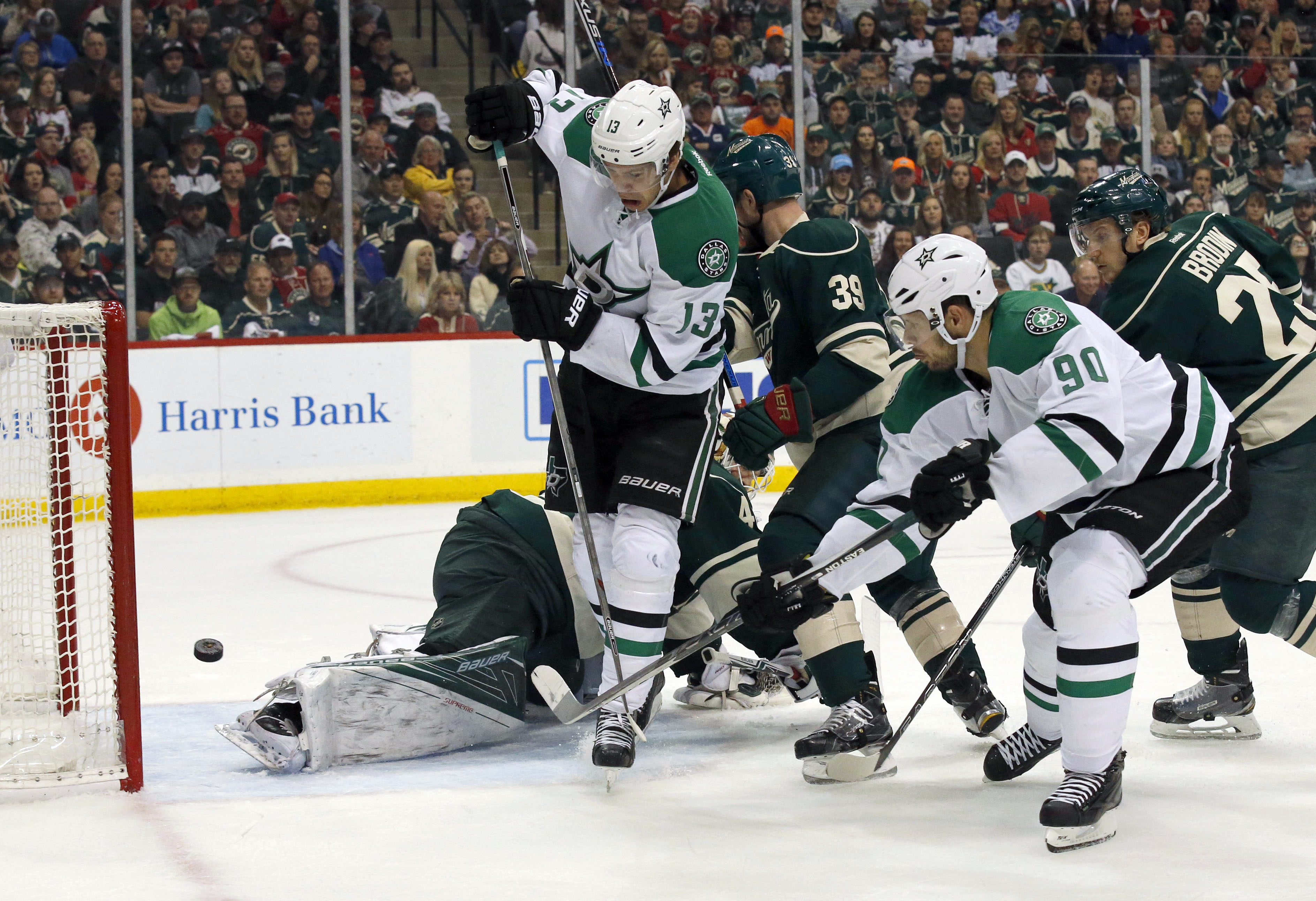 Dallas Stars center Jason Spezza (90) scores on Minnesota Wild goalie Devan Dubnyk past Stars teammate Mattias Janmark (13) during the first period of Game 6 in the first round of the NHL Stanley Cup hockey playoffs in St. Paul, Minn., Sunday, April 24, 2
