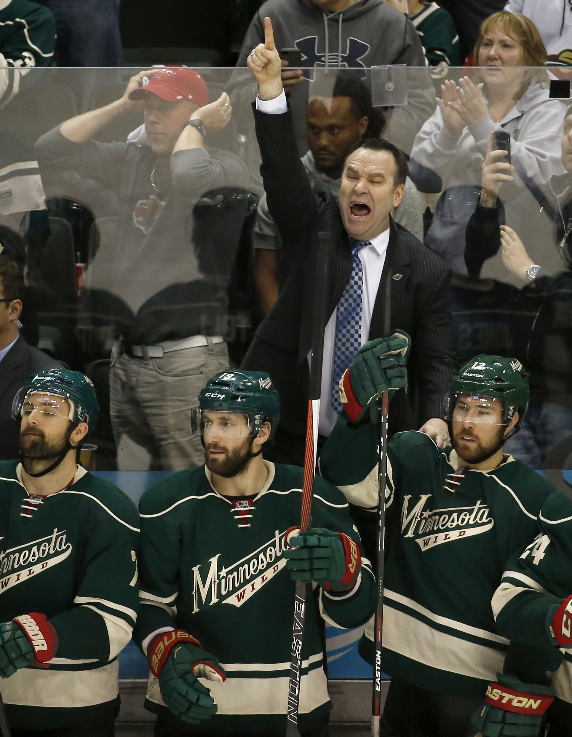 Minnesota Wild head coach John Torchetti, top, yells from the bench during the third period of Game 6 in the first round of the NHL Stanley Cup playoffs against the Dallas Stars in St. Paul, Minn., Sunday, April 24, 2016. The Stars won 5-4 to advance to t