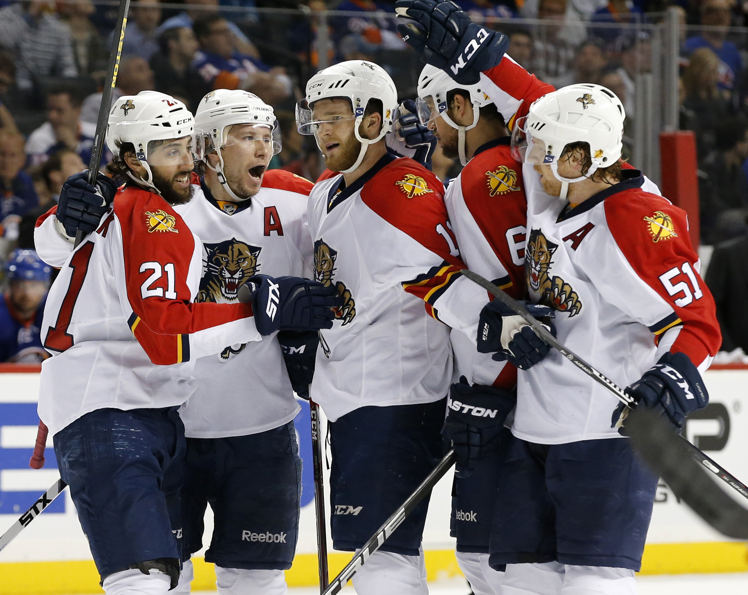 Teammates celebrate with Florida Panthers center Jonathan Huberdeau, center, after he scored a goal in the first period of Game 6 of an NHL hockey first-round Stanley Cup playoff series against the New York Islanders in New York, Sunday, April 24, 2016. (