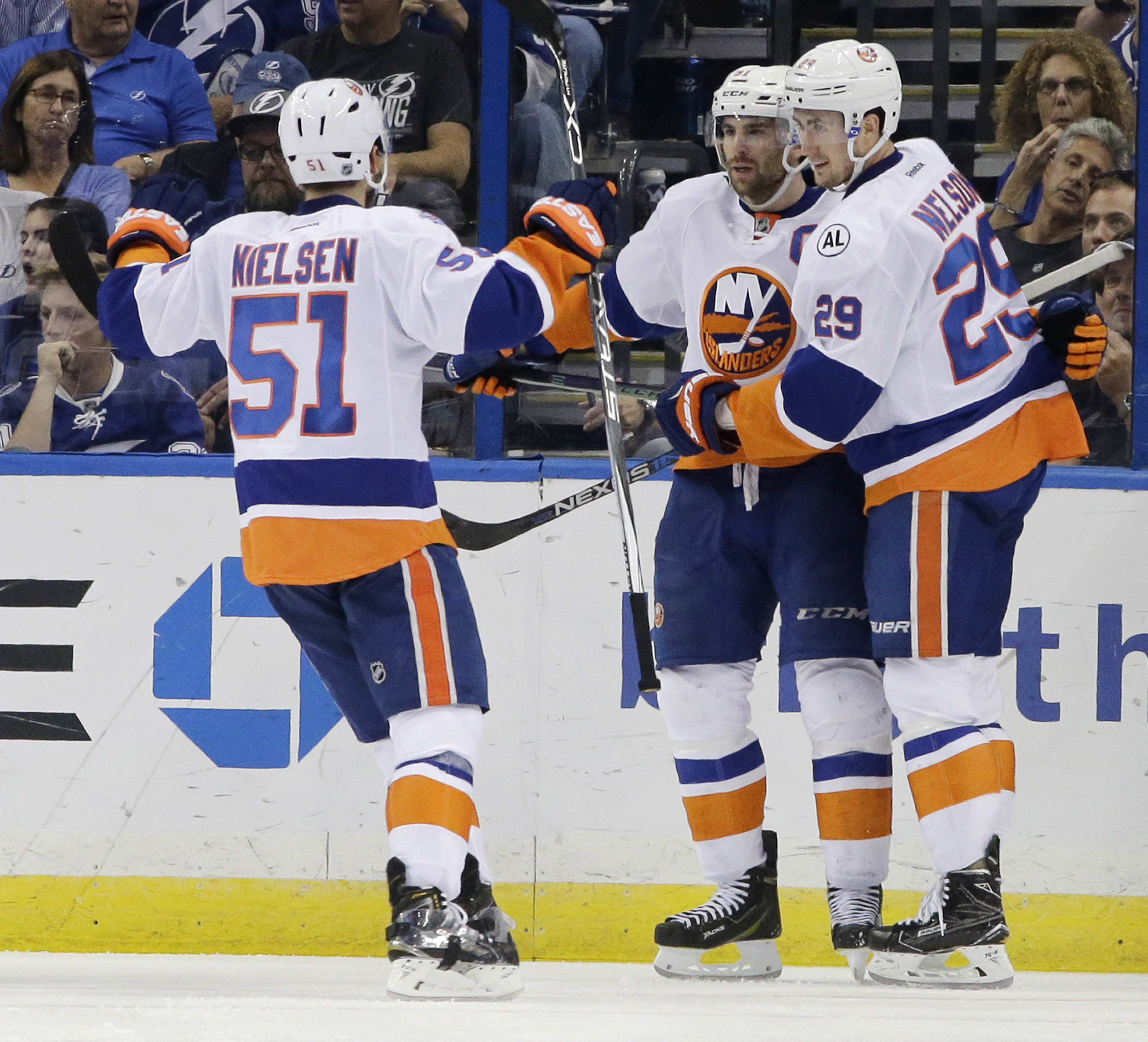 New York Islanders' John Tavares, center, is congratulated by Frans Nielsen (51), of Denmark, and Brock Nelson (29), after Tavares scored a goal during the second period of Game 1 of the NHL hockey Stanley Cup Eastern Conference semifinals against the Tam