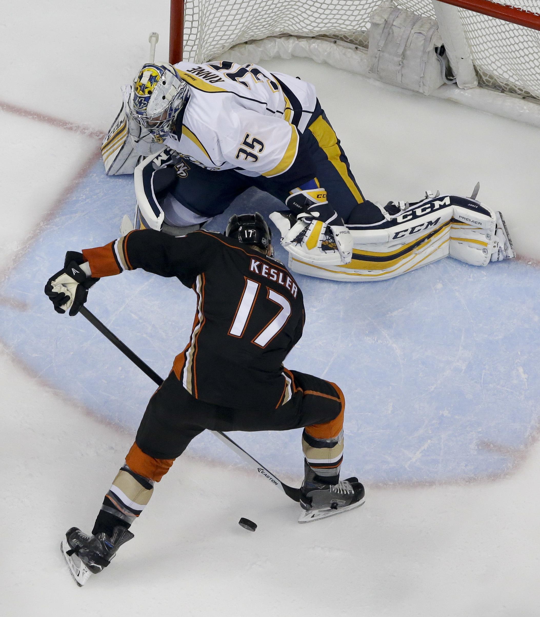 Nashville Predators goalie Pekka Rinne, top, blocks a shot by Anaheim Ducks center Ryan Kesler during the second period of Game 7 in an NHL hockey Stanley Cup playoffs first-round series in Anaheim, Calif., Wednesday, April 27, 2016. (AP Photo/Chris Carls