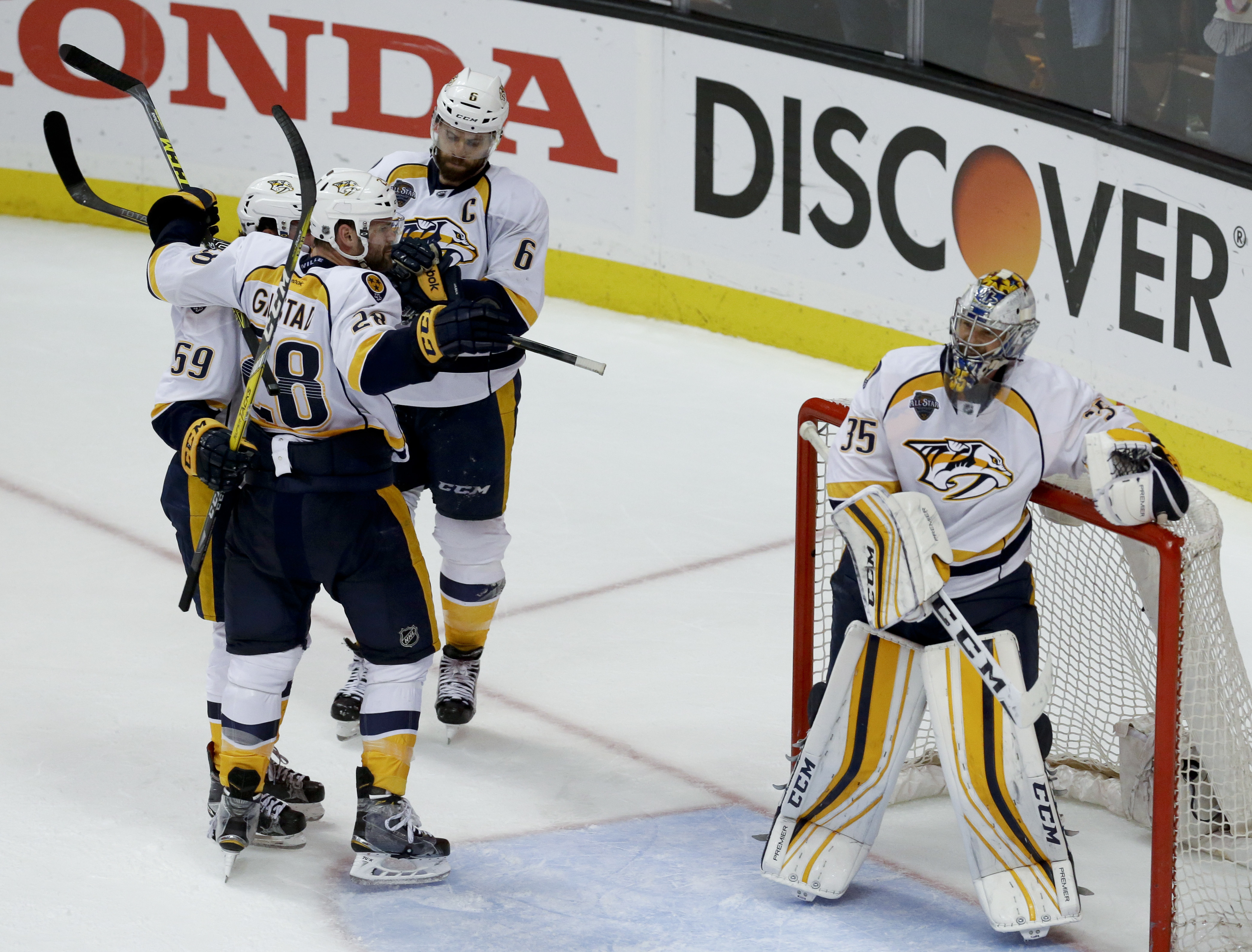 Nashville Predators celebrates a 2-1 win against the Anaheim Ducks, as goalie Pekka Rinne stands in front of the net, after Game 7 in an NHL hockey Stanley Cup playoffs first-round series in Anaheim, Calif., Wednesday, April 27, 2016. (AP Photo/Chris Carl