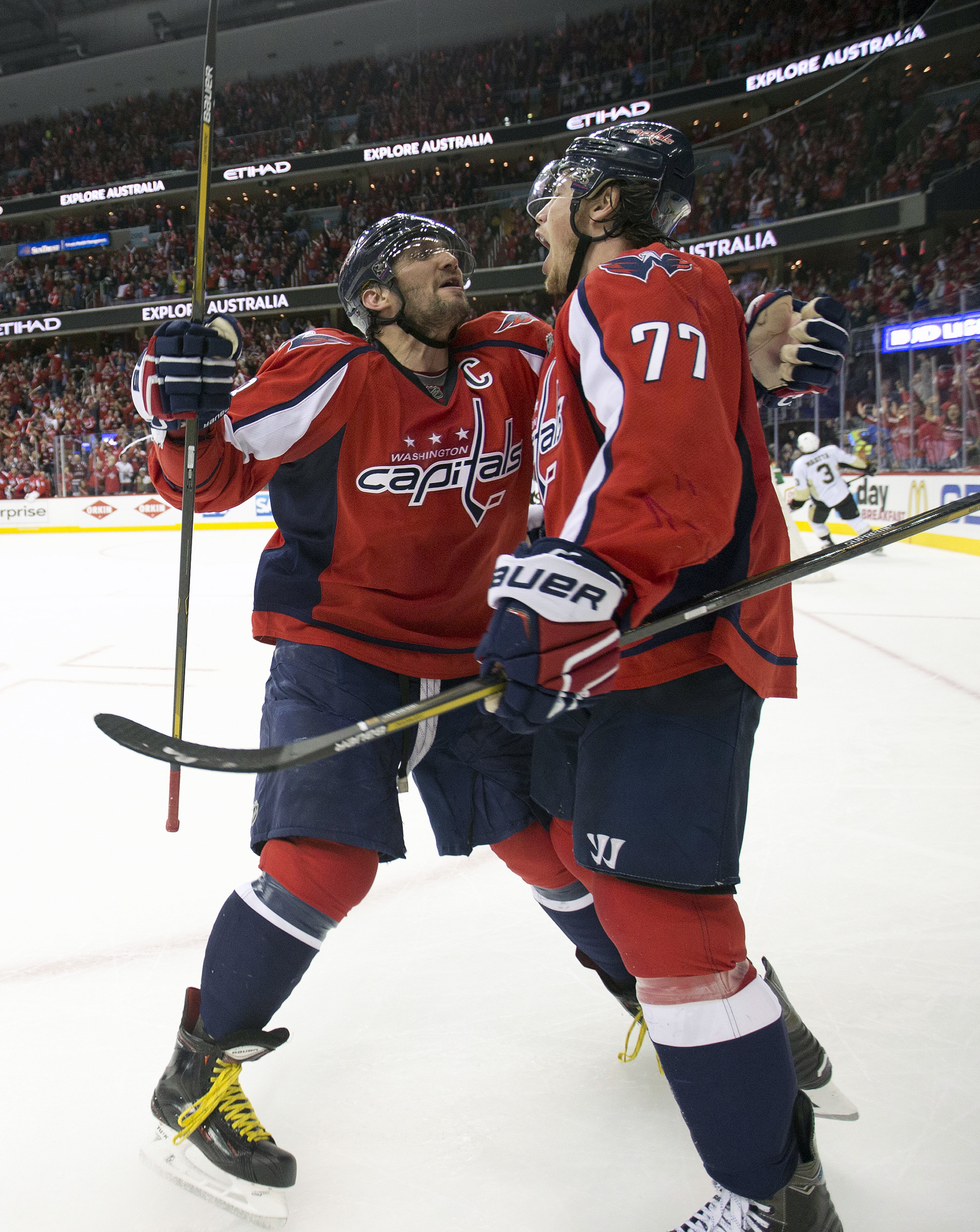 Washington Capitals right wing T.J. Oshie celebrates his goal with teammate Alex Ovechkin (8) against the Pittsburgh Penguins during the second period of Game 1 in an NHL hockey Stanley Cup Eastern Conference semifinals Thursday, April 28, 2016 in Washing