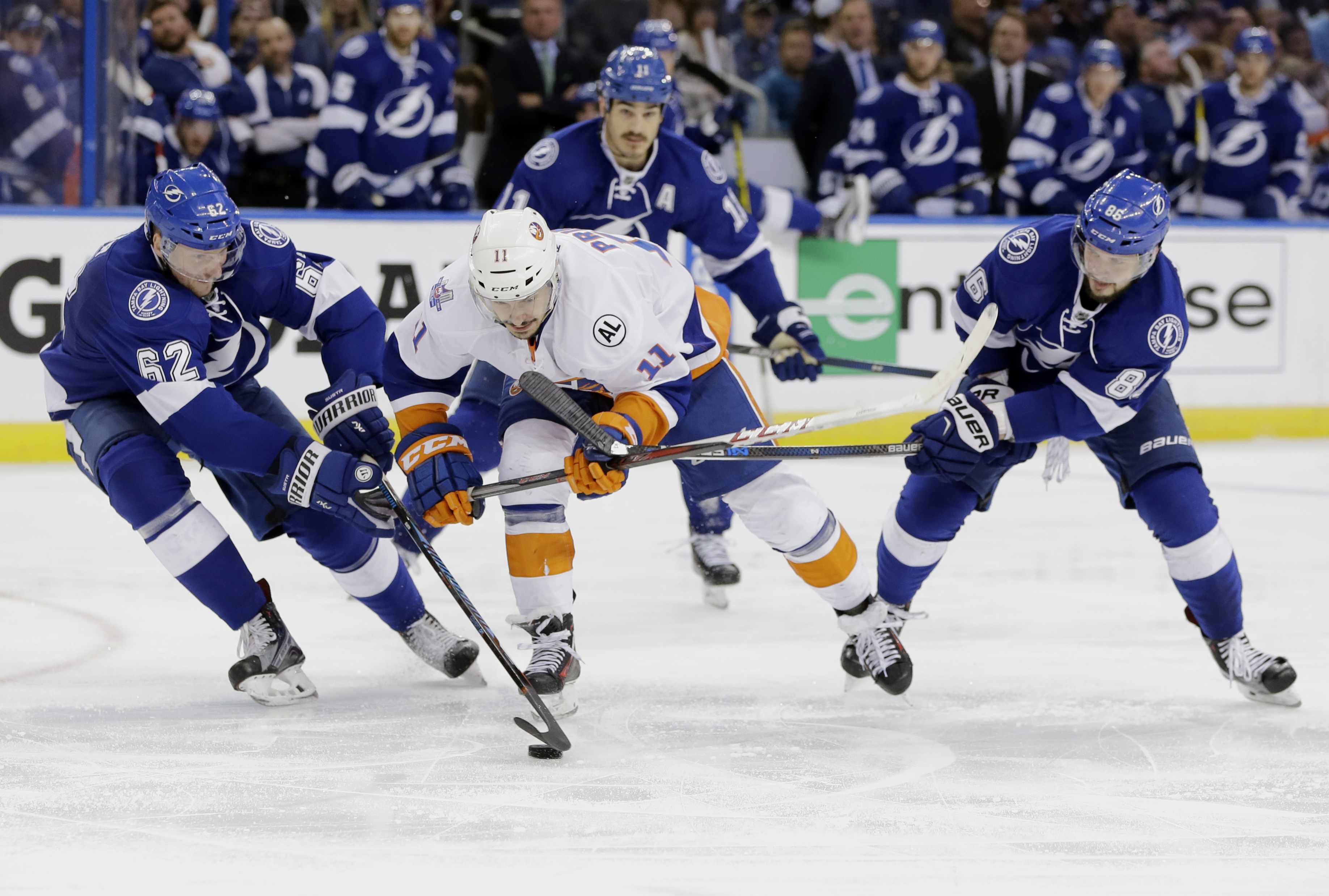 Tampa Bay Lightning defenseman Andrej Sustr (62), of the Czech Republic, takes control of the puck from New York Islanders center Shane Prince (11) as Tampa Bay Lightning right wing Nikita Kucherov (86), of Russia, defends, during the third period of Game