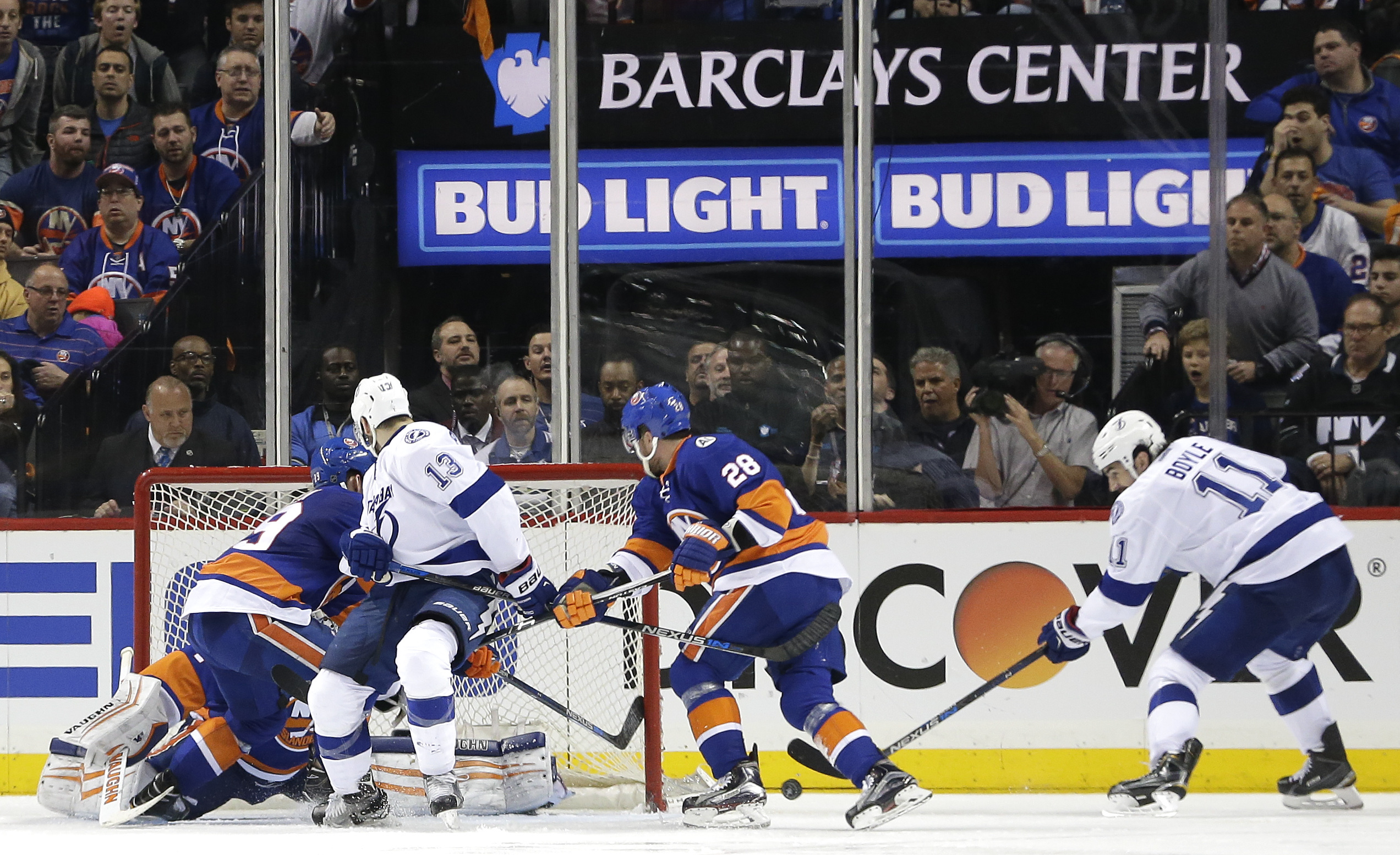 Tampa Bay Lightning center Brian Boyle (11) takes the puck off the boards and shoots to score a goal against the New York Islanders during the overtime period of Game 3 of the NHL hockey Stanley Cup Eastern Conference semifinals, Tuesday, May 3, 2016, in