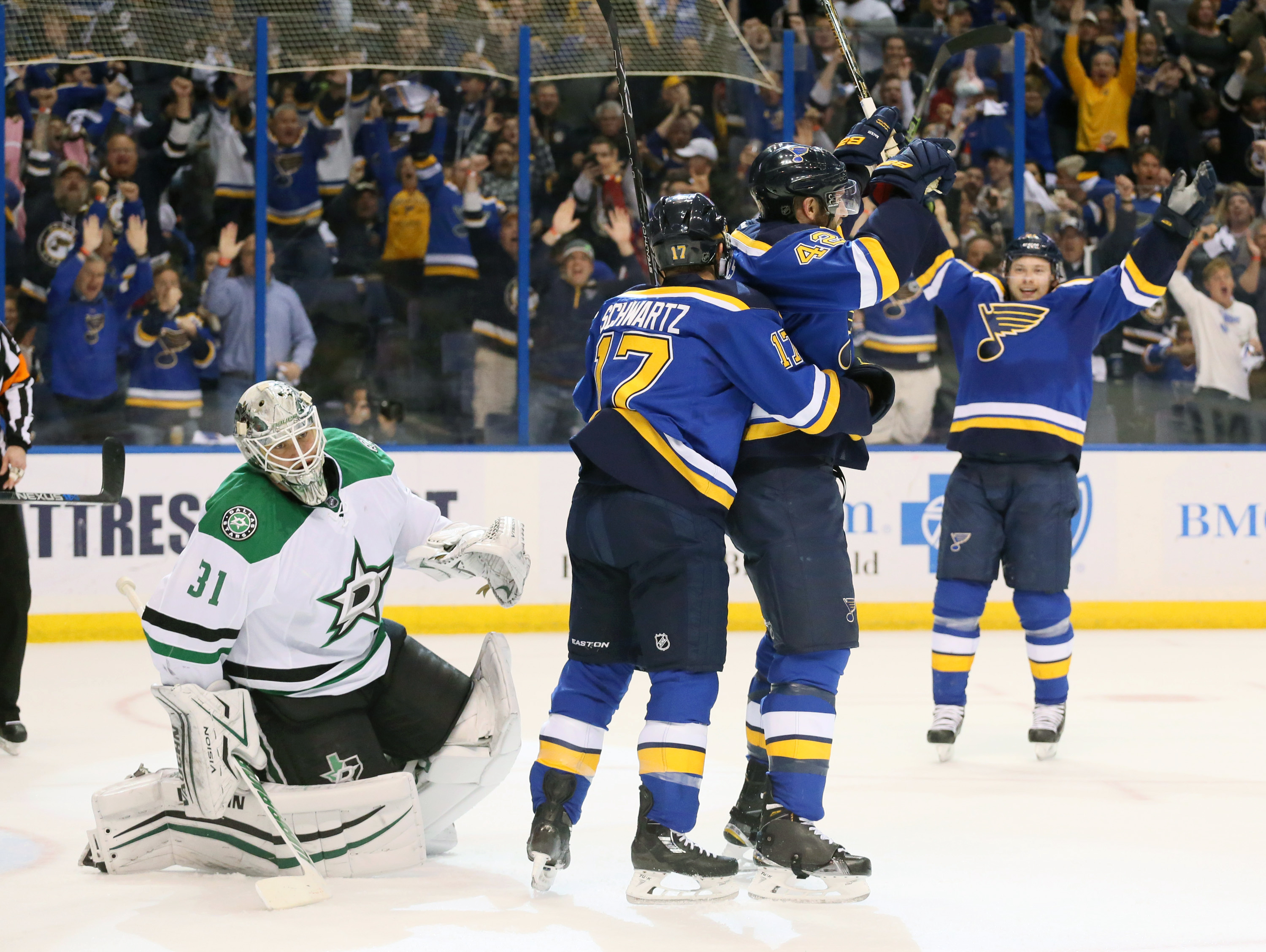 St. Louis Blues left wing Jaden Schwartz (17) celebrates with right wing David Backes (42) after Backes scored past Dallas Stars goaltender Antti Niemi in the first period of Game 3 of the NHL hockey Stanley Cup Western Conference semifinals, Tuesday, May