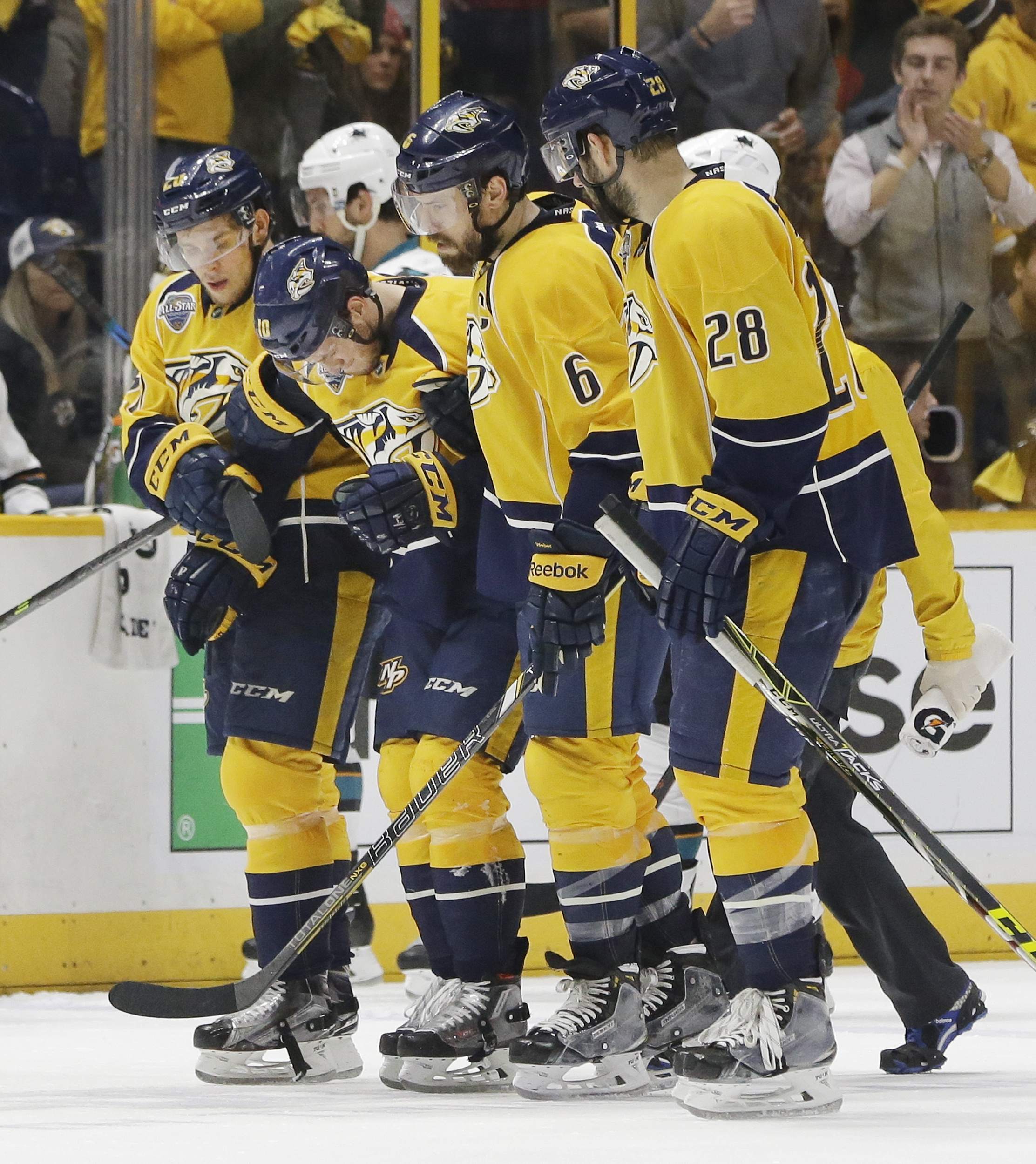 Nashville Predators center Colton Sissons, second from left, is helped off the ice by Miikka Salomaki (20), of Finland, left, Shea Weber (6) and Paul Gaustad (28) after Sissons was injured during the third period in Game 3 of an NHL hockey Stanley Cup Wes