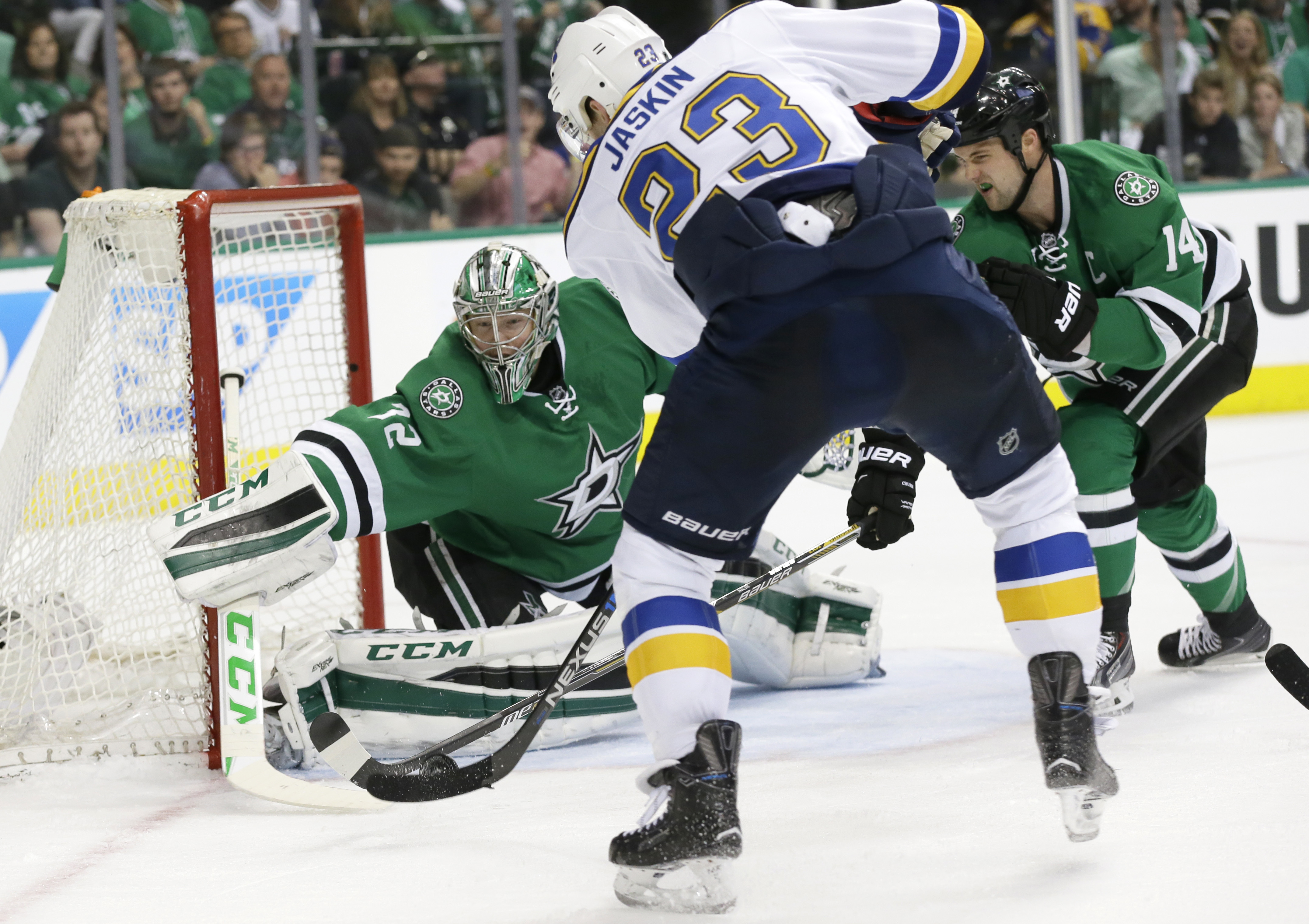 St. Louis Blues right wing Dmitrij Jaskin (23) scores a goal against Dallas Stars goalie Kari Lehtonen (32) and left wing Jamie Benn (14) during the second period of Game 5 of the NHL hockey Stanley Cup playoffs Western Conference semifinals Saturday, May