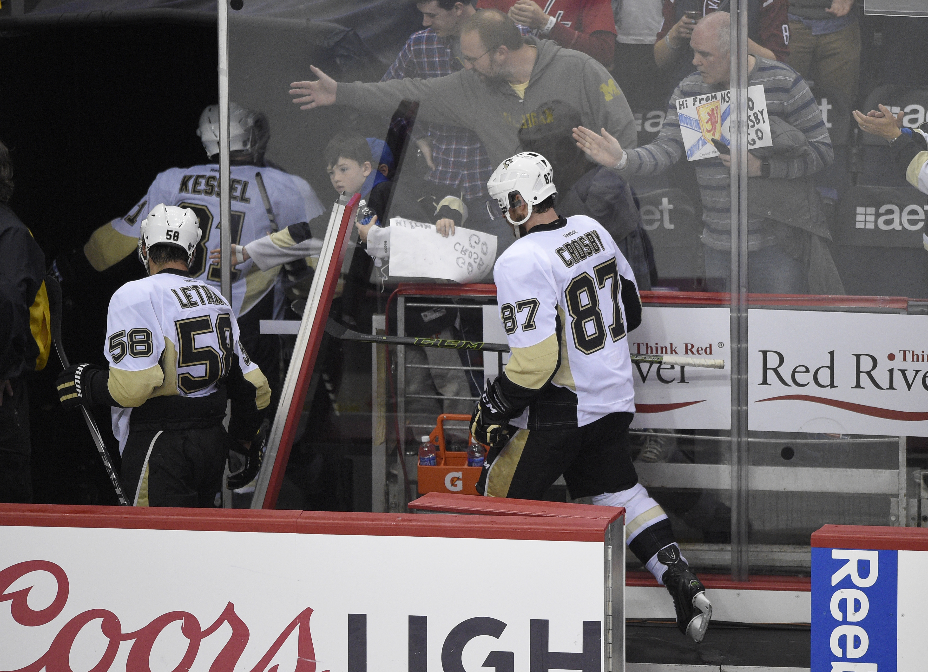 Pittsburgh Penguins center Sidney Crosby (87), Kris Letang (58) and Phil Kessel (81) leave the ice after losing 3-1 to the Washington Capitals in Game 5 in an NHL hockey Stanley Cup Eastern Conference semifinals, Saturday, May 7, 2016, in Washington. (AP