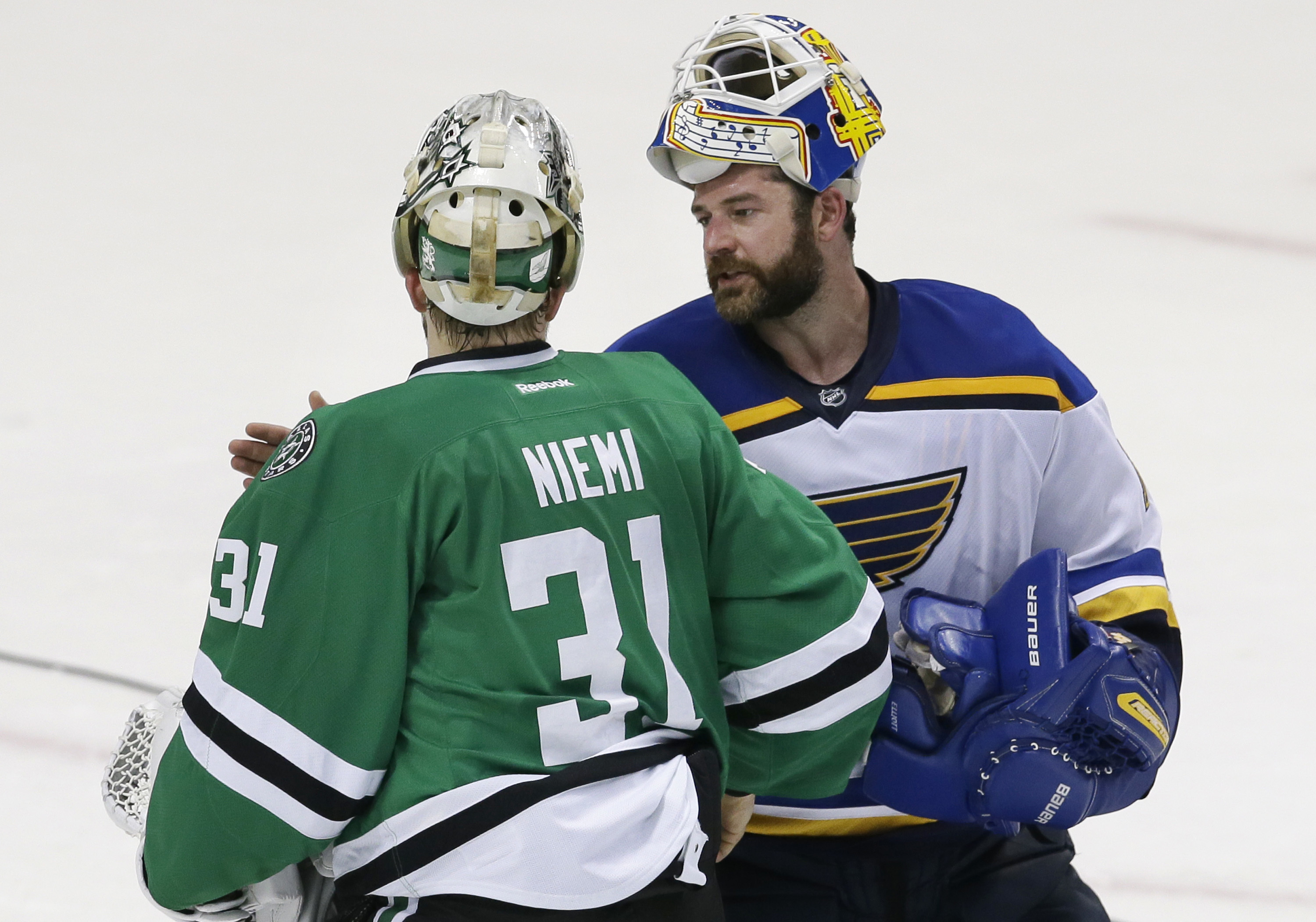 St. Louis Blues goalie Brian Elliott (1) and Dallas Stars goalie Antti Niemi (31) greet each other after Game 7 of the NHL hockey Stanley Cup Western Conference semifinals Wednesday, May 11, 2016, in Dallas. The Blues won 6-1. (AP Photo/LM Otero)