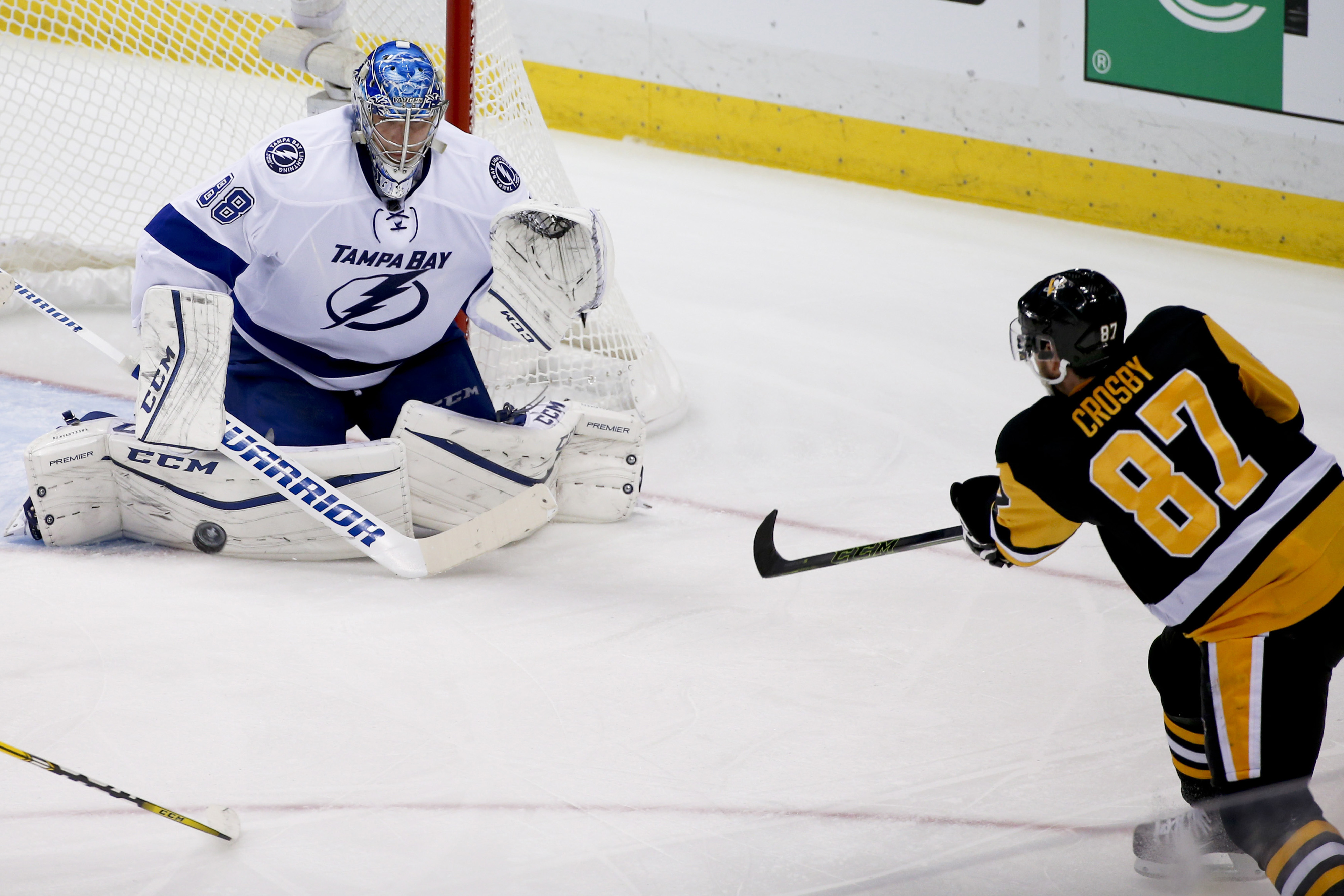 Tampa Bay Lightning goalie Andrei Vasilevskiy, left, makes a save on Pittsburgh Penguins' Sidney Crosby (87) during the third period of Game 2 of the NHL hockey Stanley Cup Eastern Conference finals, Monday, May 16, 2016, in Pittsburgh. (AP Photo/Gene J.