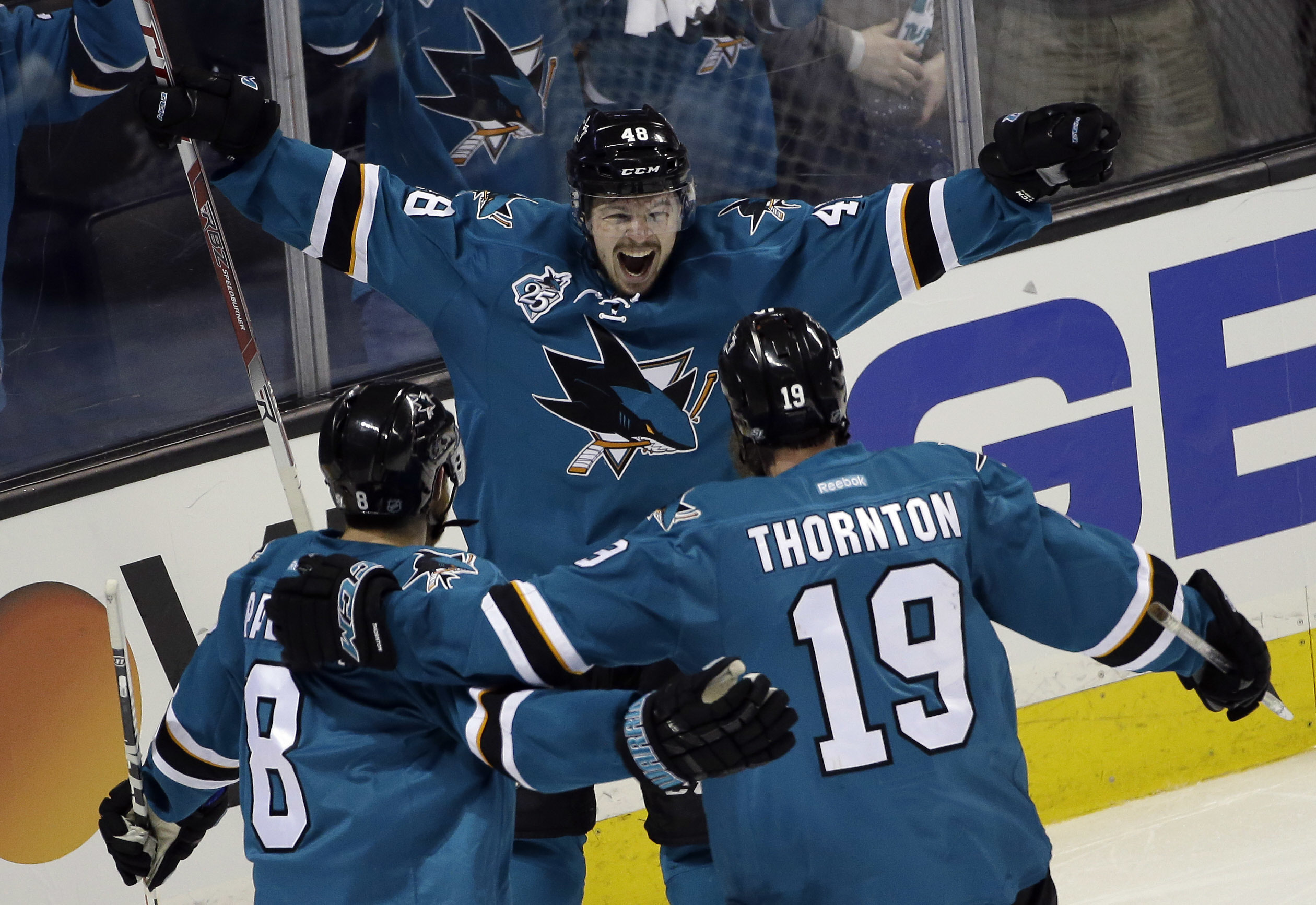 San Jose Sharks' Tomas Hertl (48) celebrates his goal with teammates Joe Thornton (19) and Joe Pavelski (8) during the third period in Game 3 of the NHL hockey Stanley Cup Western Conference finals against the St. Louis Blues on Thursday, May 19, 2016, in