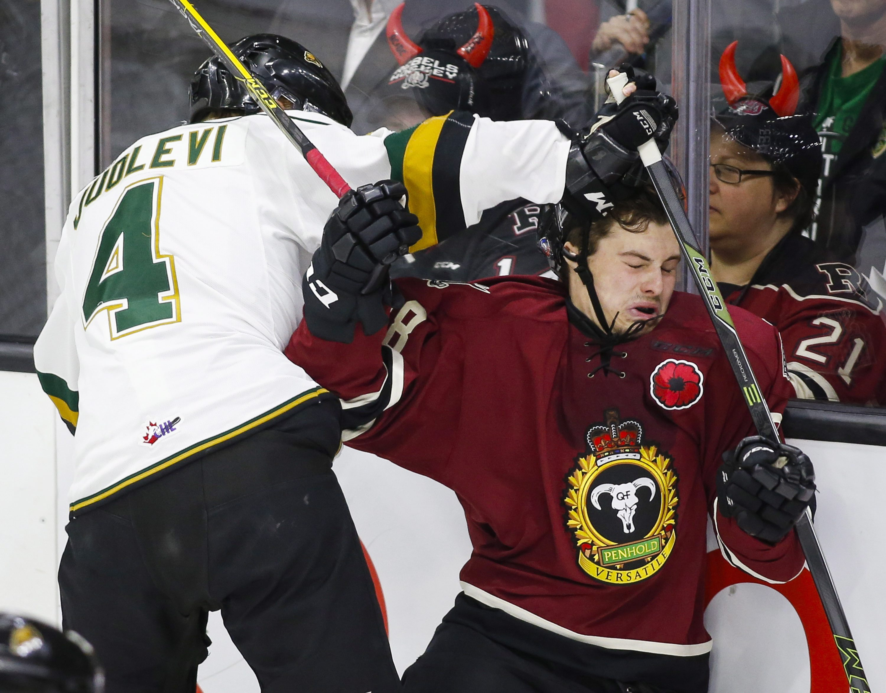 London Knights' Olli Juolevi, left, from Finland, brings down Red Deer Rebels' Adam Helewka during the first period of a CHL Memorial Cup hockey game in Red Deer, Alberta, Friday, May 20, 2016. (Jeff McIntosh/The Canadian Press via AP)