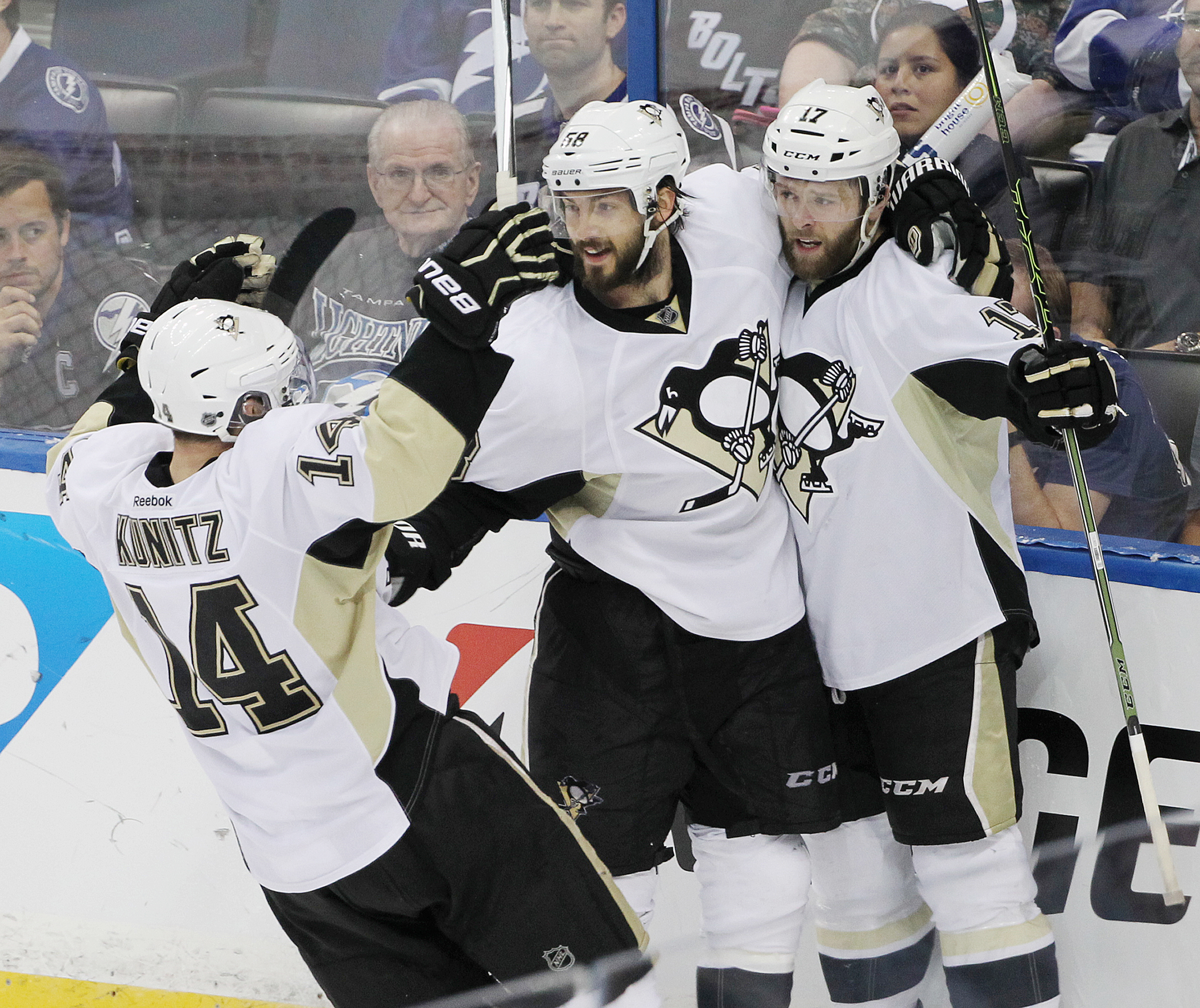 Pittsburgh Penguins defenseman Kris Letang (58) and left wing Chris Kunitz (14) celebrate Bryan Rust's (17) goal during the third period of Game 6 of the NHL hockey Stanley Cup Eastern Conference finals Tuesday, May 24, 2016, in Tampa, Fla. The Penguins d