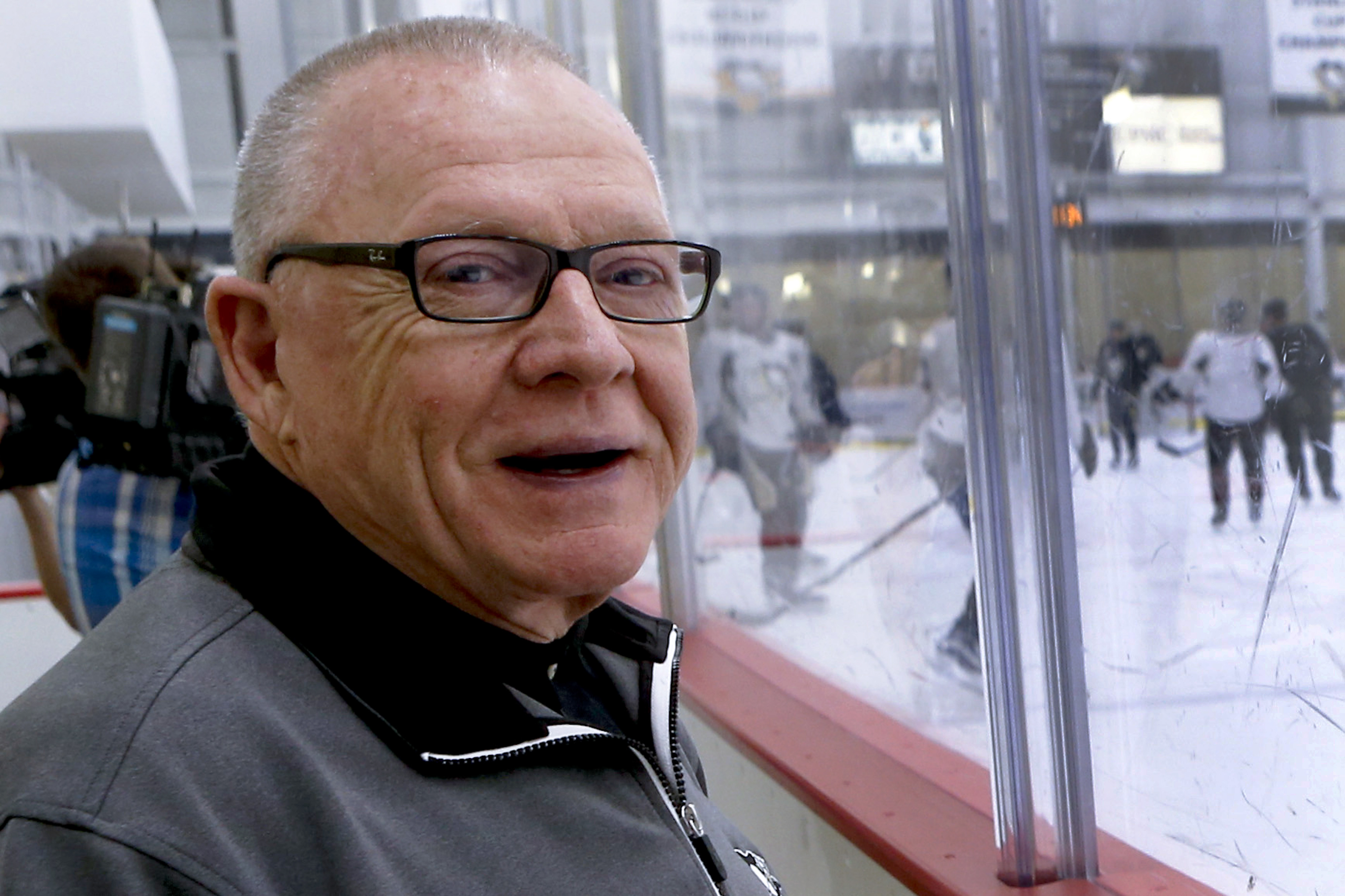 Pittsburgh Penguins general manager Jim Rutherford stands behind the glass as the team works out during NHL hockey practice at the UPMC Lemieux Sports Complex, Saturday, May 28, 2016, in Cranberry, Pa. The Penguins host the San Jose Sharks in Game 1 of th