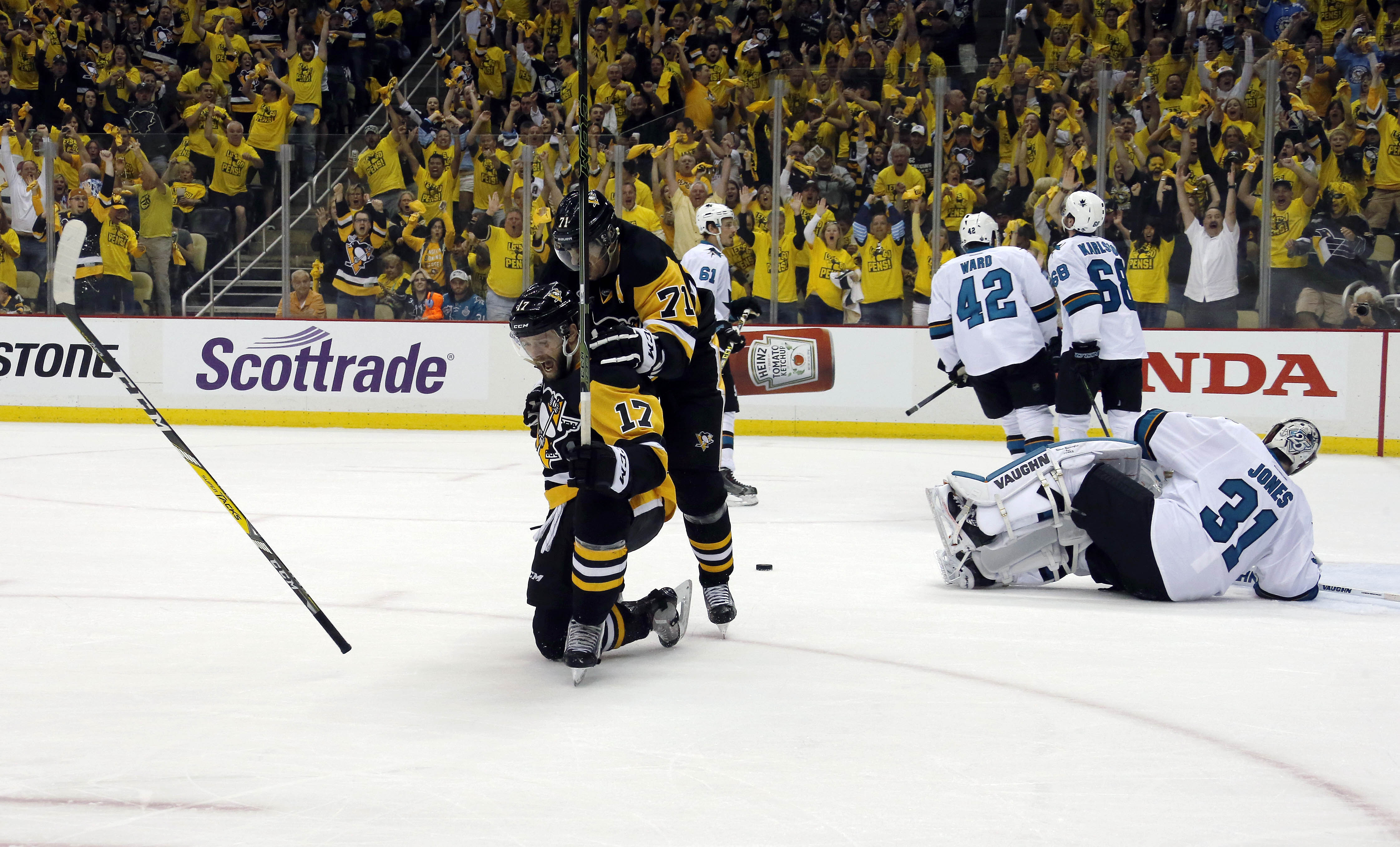 Pittsburgh Penguins' Bryan Rust (17) celebrates with Evgeni Malkin (71) his goal against San Jose Sharks goalie Martin Jones (31) during the first period in Game 1 of the Stanley Cup final series Monday, May 30, 2016, in Pittsburgh. (AP Photo/Keith Srakoc