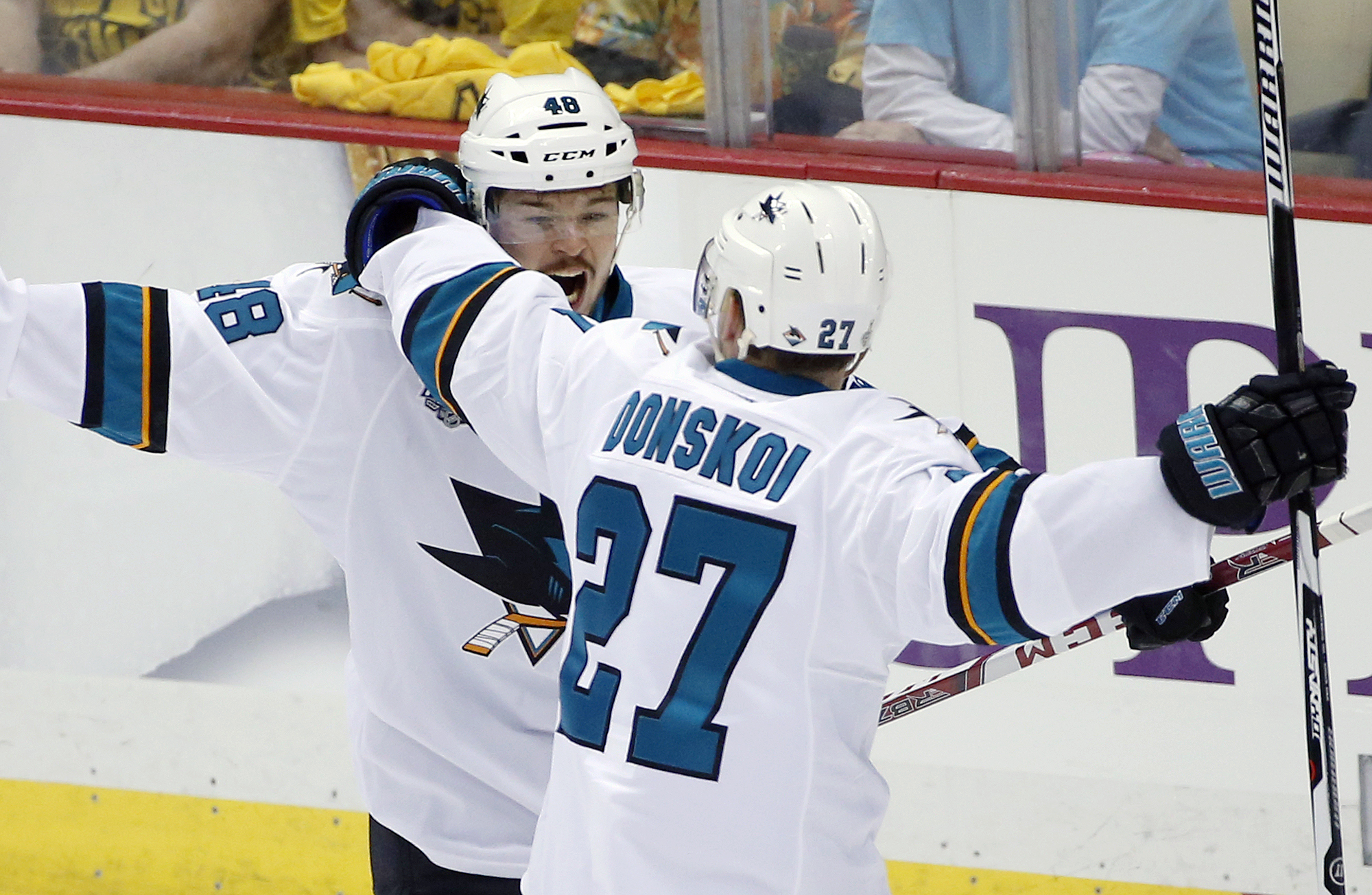 San Jose Sharks' Tomas Hertl, left, celebrates his goal against the Pittsburgh Penguins with Joonas Donskoi during the second period in Game 1 of the Stanley Cup final series Monday, May 30, 2016, in Pittsburgh. (AP Photo/Gene J. Puskar)
