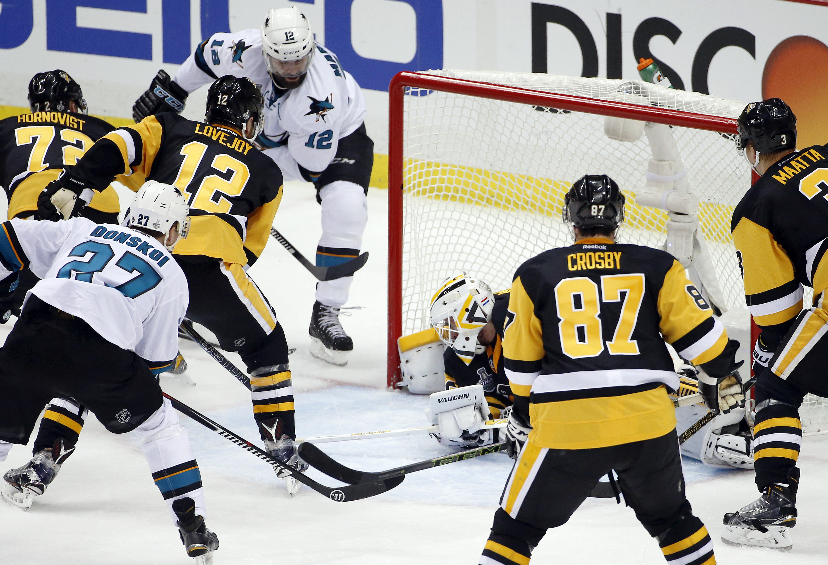 San Jose Sharks' Patrick Marleau (12) scores past Pittsburgh Penguins goalie Matt Murray (30) during the second period in Game 1 of the Stanley Cup final series Monday, May 30, 2016, in Pittsburgh. (AP Photo/Gene J. Puskar)