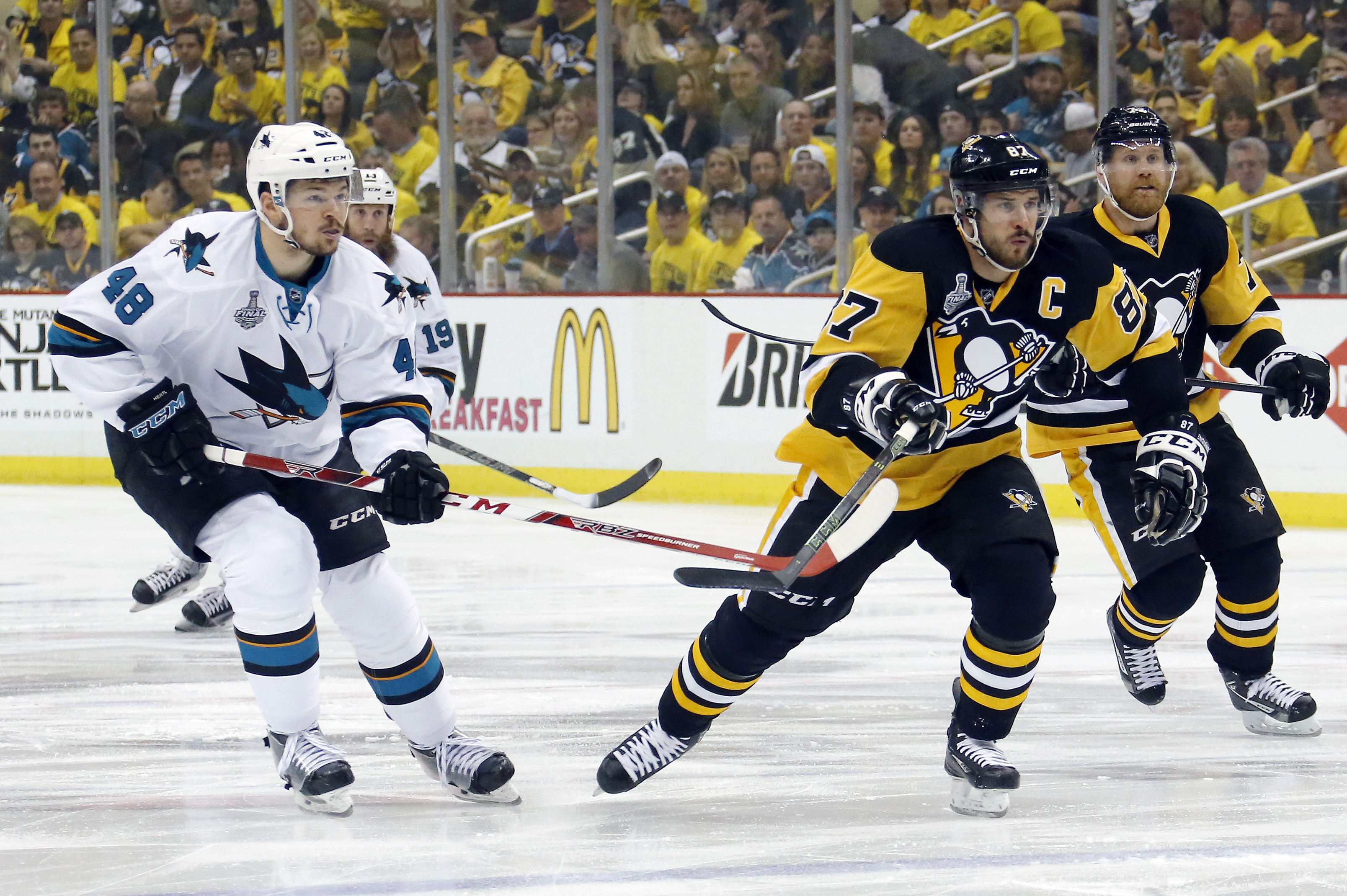 Pittsburgh Penguins' Sidney Crosby (87) skates past San Jose Sharks' Tomas Hertl (48) during the first period in Game 2 of the NHL hockey Stanley Cup Finals on Wednesday, June 1, 2016, in Pittsburgh. (AP Photo/Keith Srakocic)