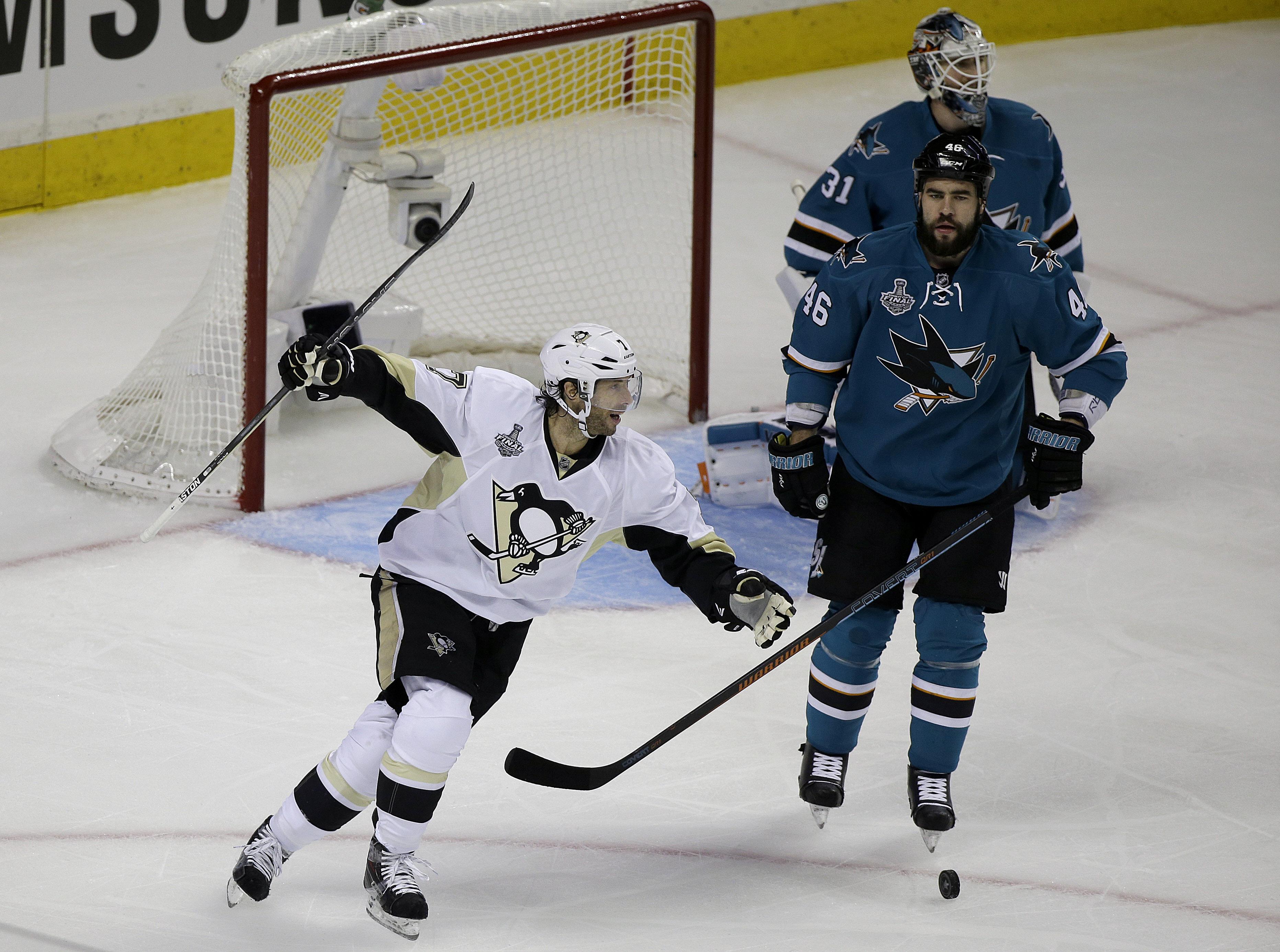Pittsburgh Penguins center Matt Cullen, left, celebrates after teammate Ben Lovejoy scored a goal as San Jose Sharks defenseman Roman Polak (46), from the Czech Republic, and goalie Martin Jones react during the first period of Game 3 of the NHL hockey St