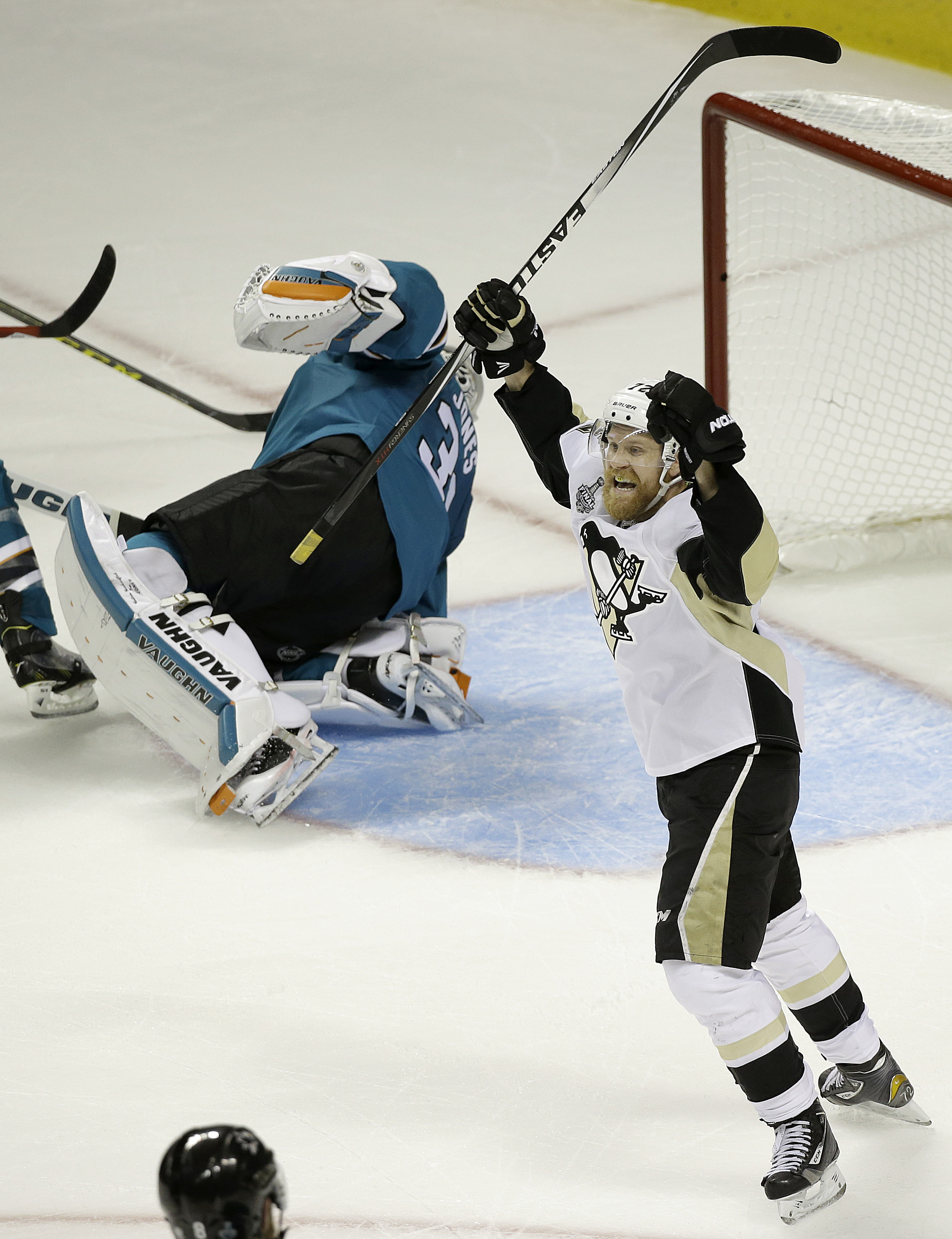 Pittsburgh Penguins right wing Patric Hornqvist, from Sweden, right, celebrates after scoring against San Jose Sharks goalie Martin Jones, left, during the second period of Game 3 of the NHL hockey Stanley Cup Finals in San Jose, Calif., Saturday, June 4,