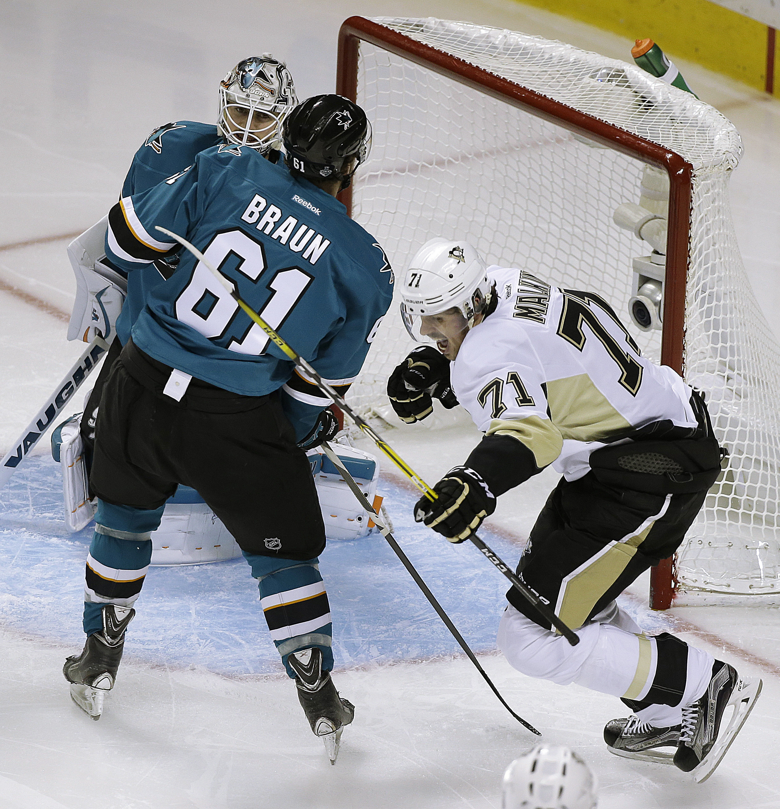 Pittsburgh Penguins' Evgeni Malkin, right, celebrates after scoring a goal against San Jose Sharks goalie Martin Jones and Justin Braun (61) during the second period of Game 4 of the NHL hockey Stanley Cup Finals on Monday, June 6, 2016, in San Jose, Cali