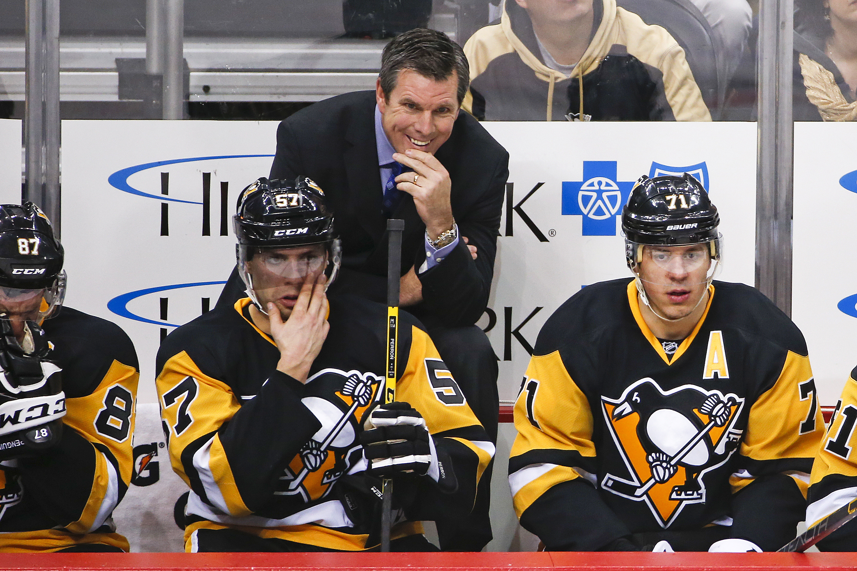 FILE - In this Jan. 2, 2016, file photo, Pittsburgh Penguins head coach Mike Sullivan stands behind David Perron (57), and Evgeni Malkin (71) during an NHL hockey game against the New York Islanders in Pittsburgh. The Penguins are on the cusp of a fourth