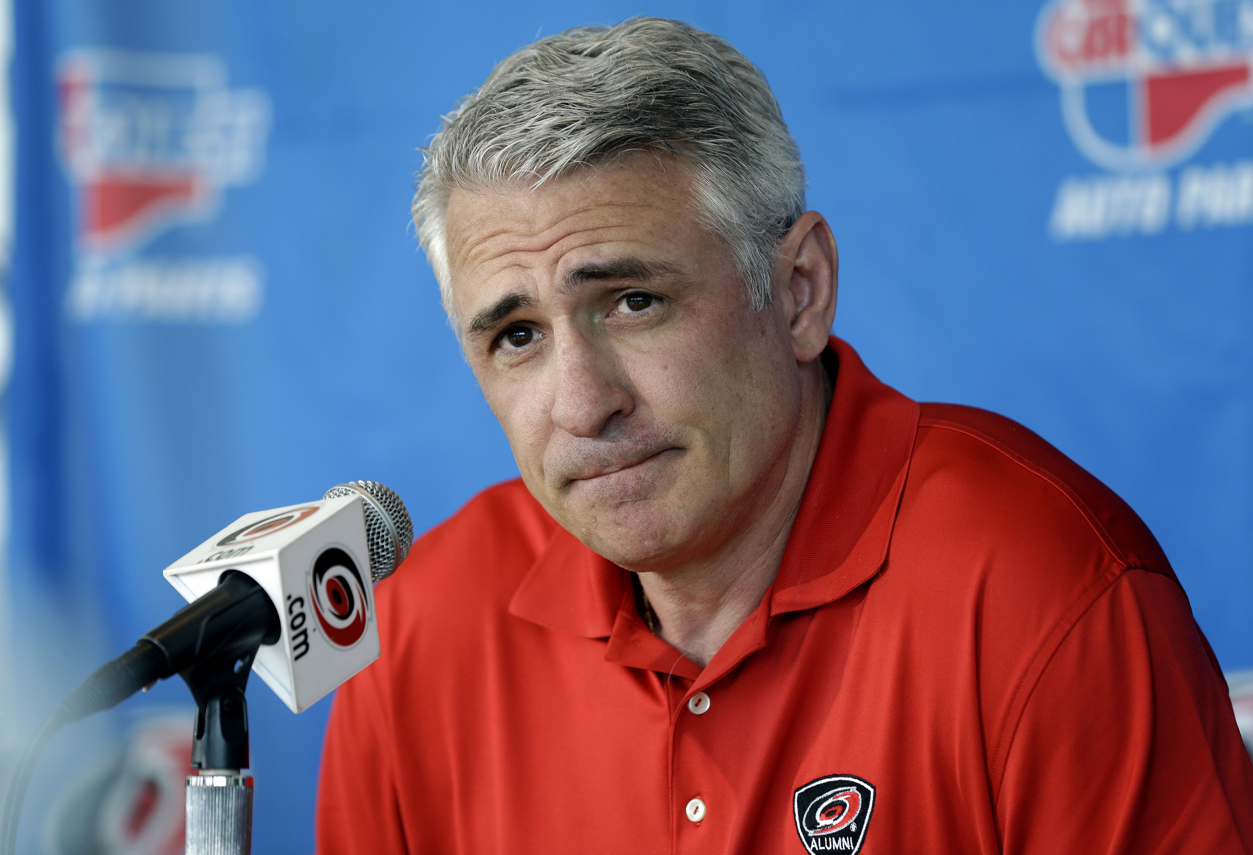 FILE - In this May 5, 2014, file photo, Carolina Hurricanes general manager Ron Francis takes questions from members of the media during a news conference in Raleigh, N.C. Francis insists the team isnt going anywhere. Francis on Thursday, June 9, 2016, be