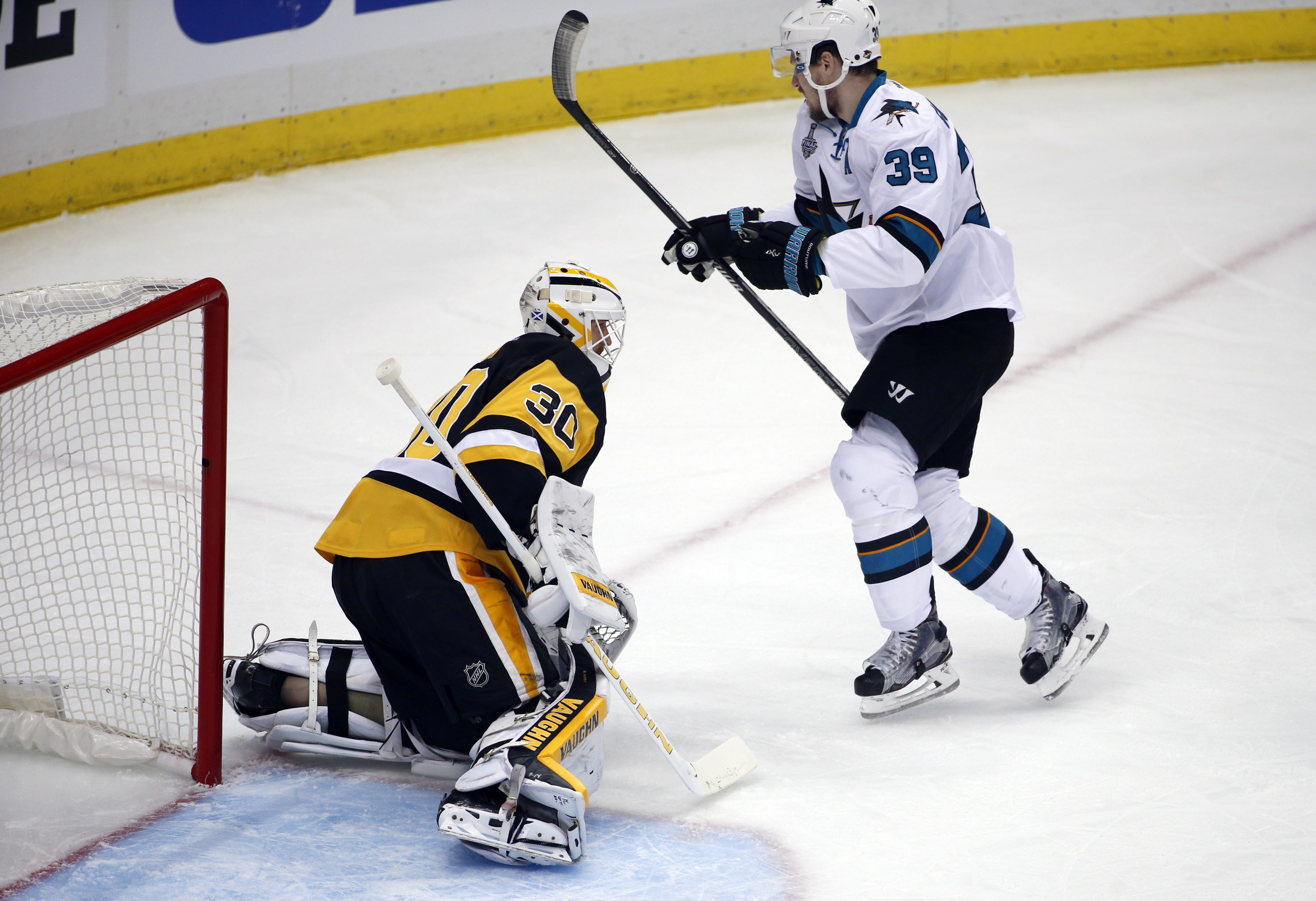 San Jose Sharks' Logan Couture (39) celebrates his goal in front of Pittsburgh Penguins goalie Matt Murray (30) during the first period in Game 5 of the NHL hockey Stanley Cup Finals on Thursday, June 9, 2016, in Pittsburgh. (AP Photo/Gene J. Puskar)