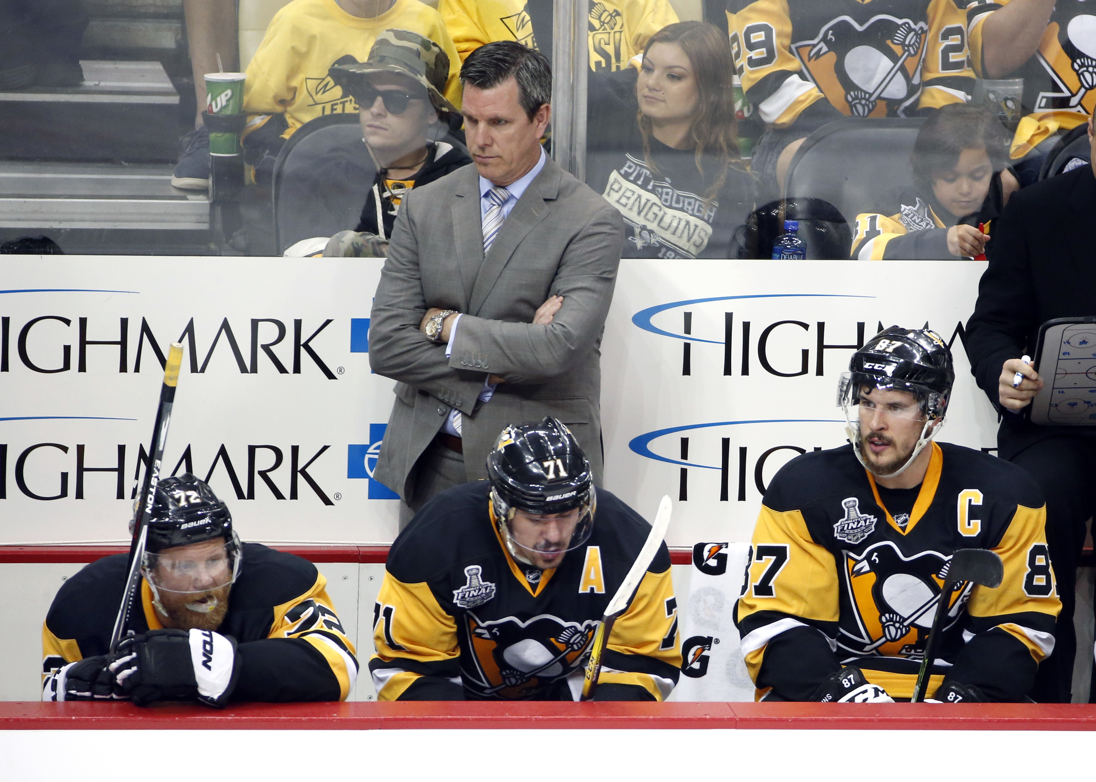 Pittsburgh Penguins coach Mike Sullivan stands behind Patric Hornqvist, Evgeni Malkin and Sidney Crosby from left, during the third period in Game 5 of the NHL hockey Stanley Cup Finals against the San Jose Sharks on Thursday, June 9, 2016, in Pittsburgh.