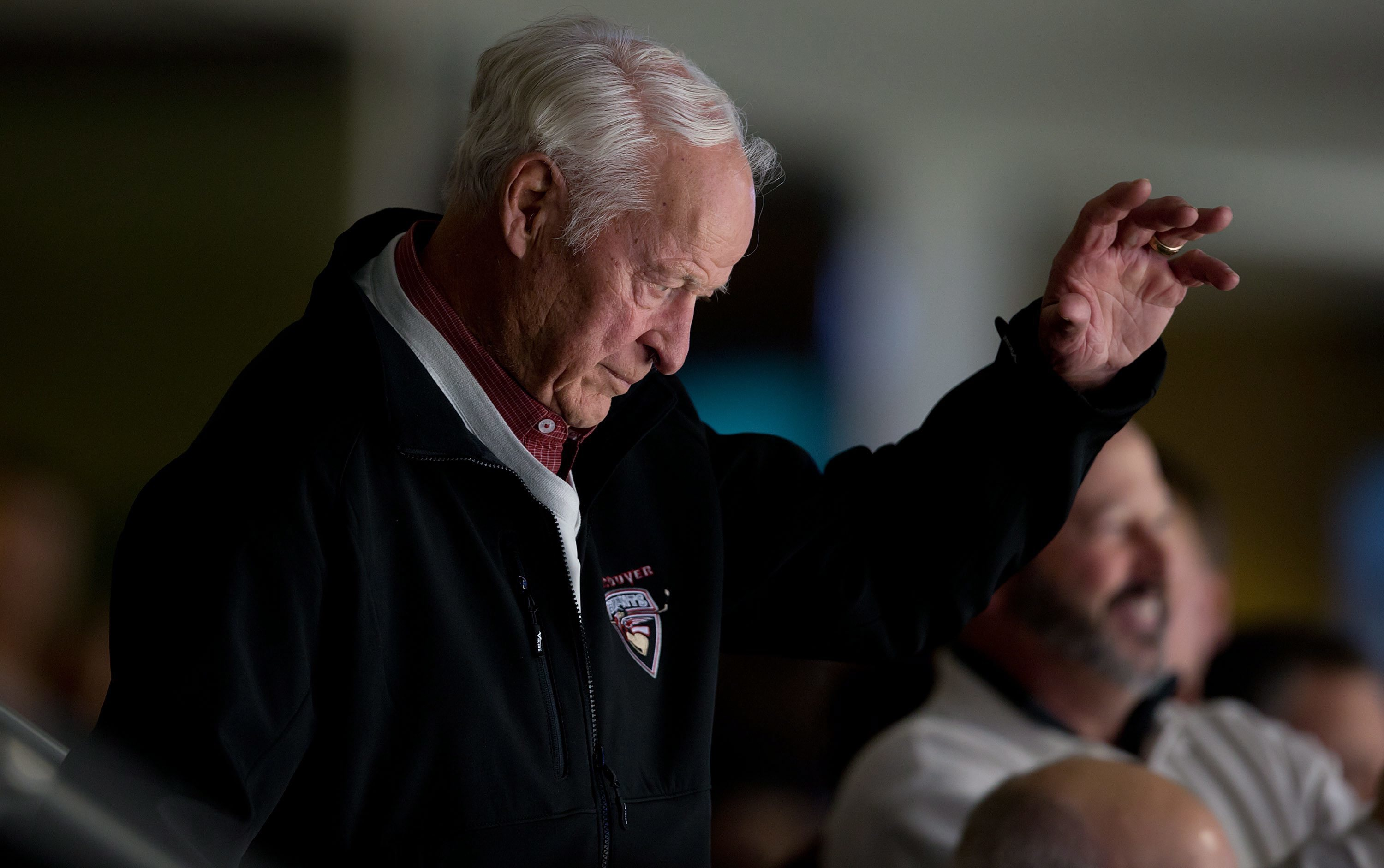 FILE - In this Nov. 14, 2013, file photo, hockey great Gordie Howe acknowledges a standing ovation from the crowd as he watches the Vancouver Canucks and San Jose Sharks play during an NHL hockey game in Vancouver, British Columbia. Gordie Howe, the hocke