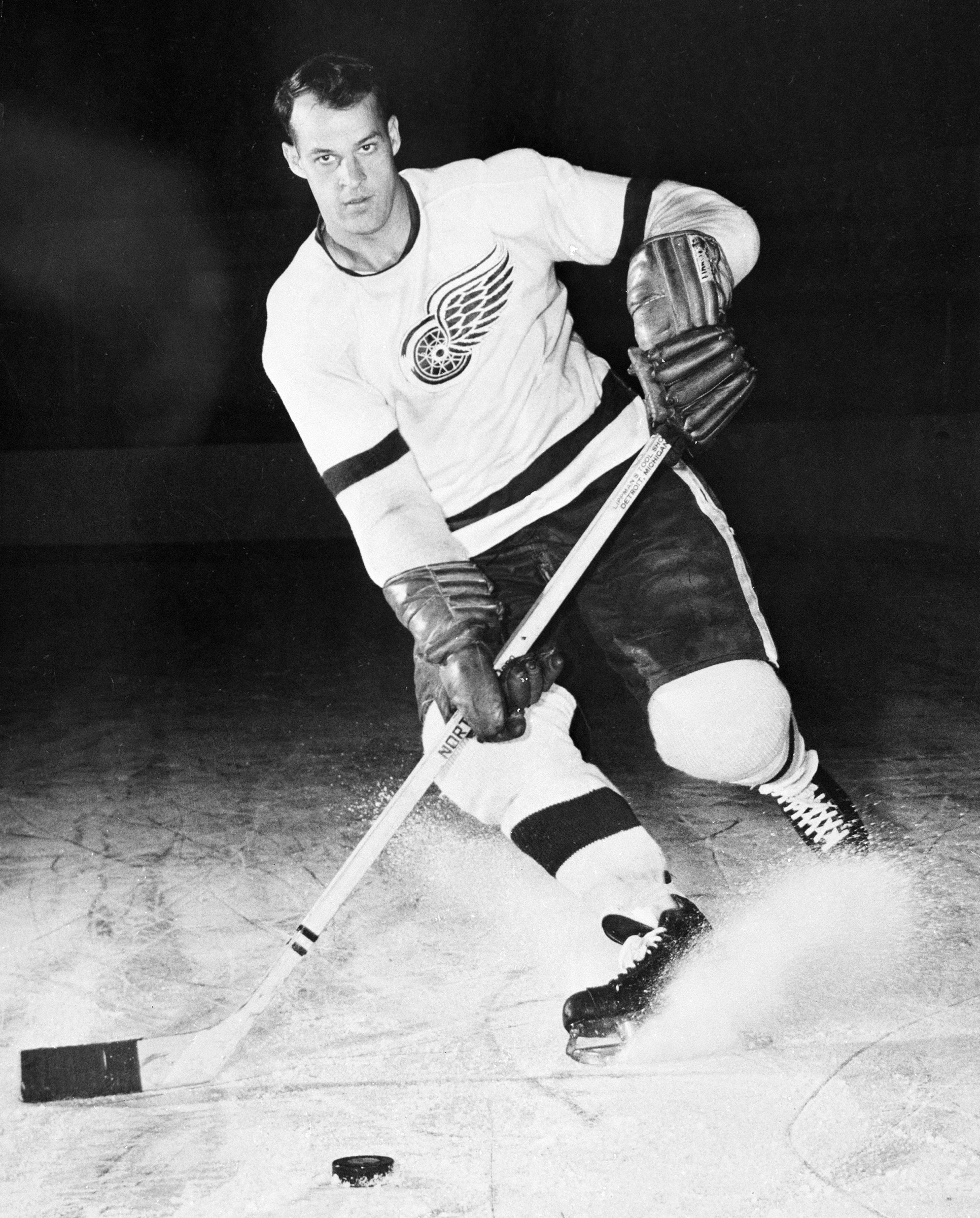 FILE - This is a 1956 file photo showing Detroit Red Wings hockey player Gordie Howe. Gordie Howe, the hockey great who set scoring records that stood for decades, has died. He was 88. Son Murray Howe confirmed the death Friday, June 10, 2016, texting to
