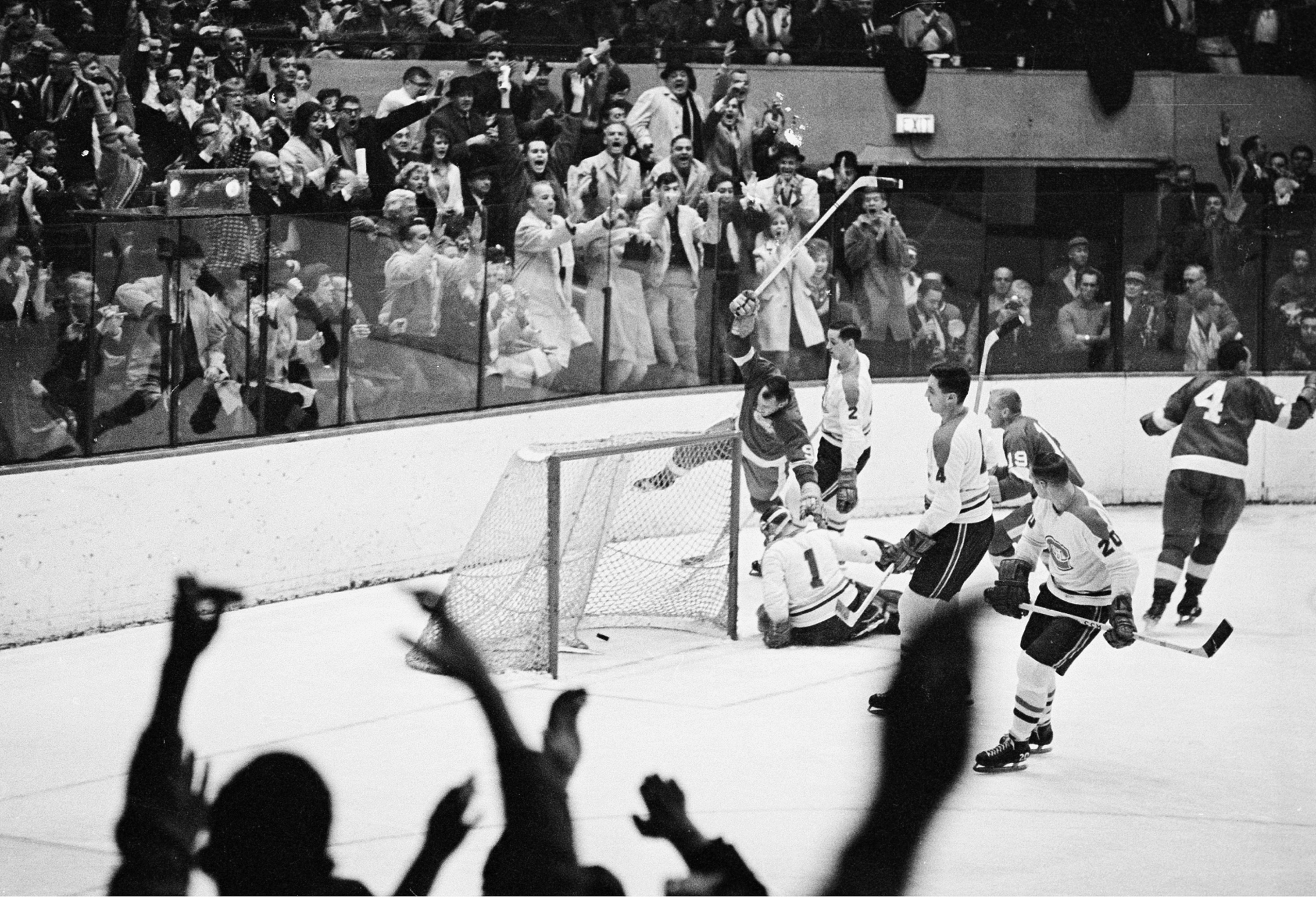FILE - In this Nov. 10, 1963, file photo, Gordie Howe (9), right-winger for the Detroit Red Wings, lifts his stick high in the air after scoring the 545th goal of his National Hockey League career in the second period against the Montreal Canadiens in Det