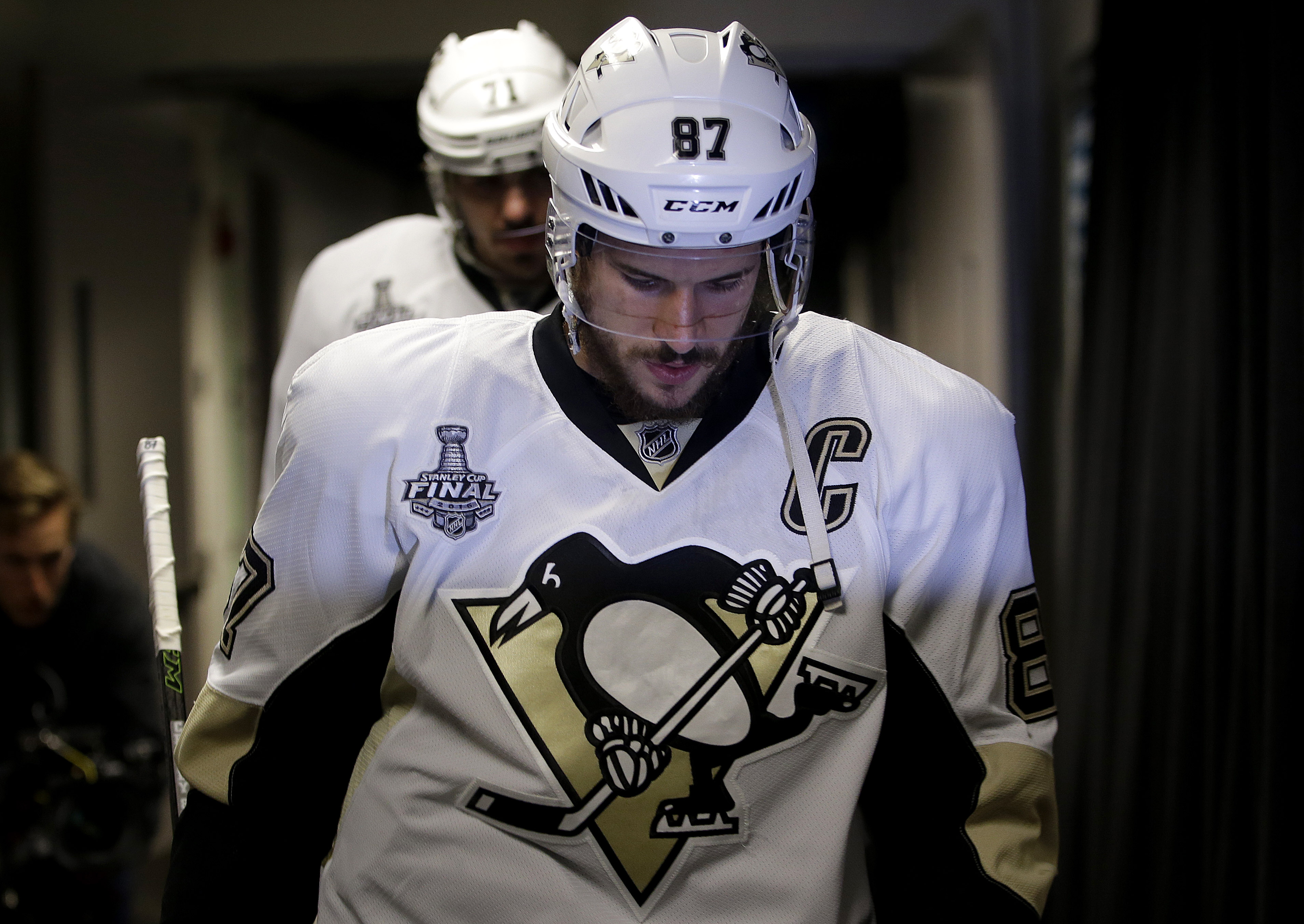Pittsburgh Penguins center Sidney Crosby walks out to the ice before Game 6 of the NHL hockey Stanley Cup Finals between the San Jose Sharks and the Penguins in San Jose, Calif., Sunday, June 12, 2016. (AP Photo/Marcio Jose Sanchez)