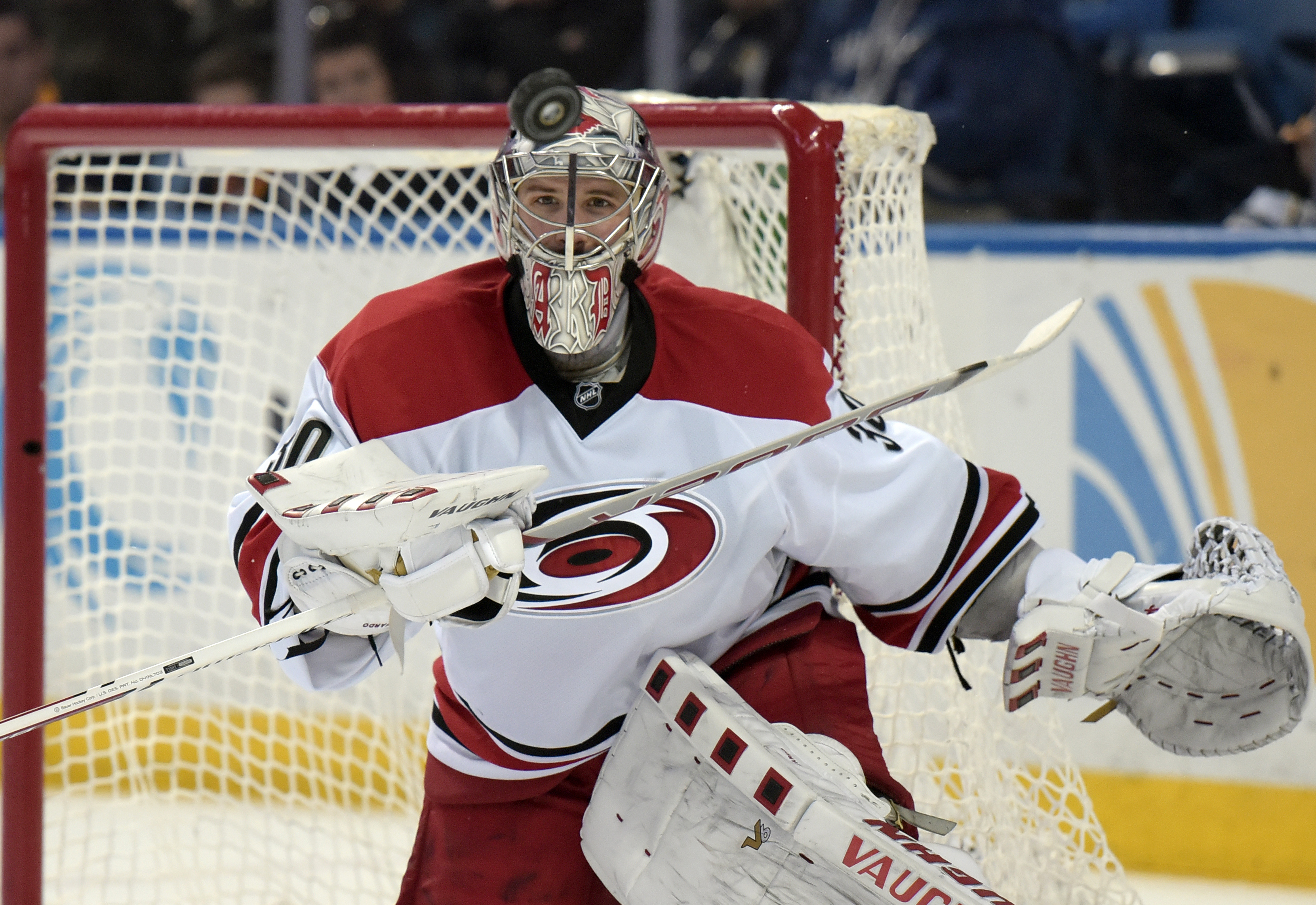 FILE - In this March 12, 2016, file photo, Carolina Hurricanes goaltender Cam Ward keeps his eye on the puck during the third period of an NHL hockey game against the Buffalo Sabres in Buffalo, N.Y. The Hurricanes announced Thursday, June 16, 2016, that t