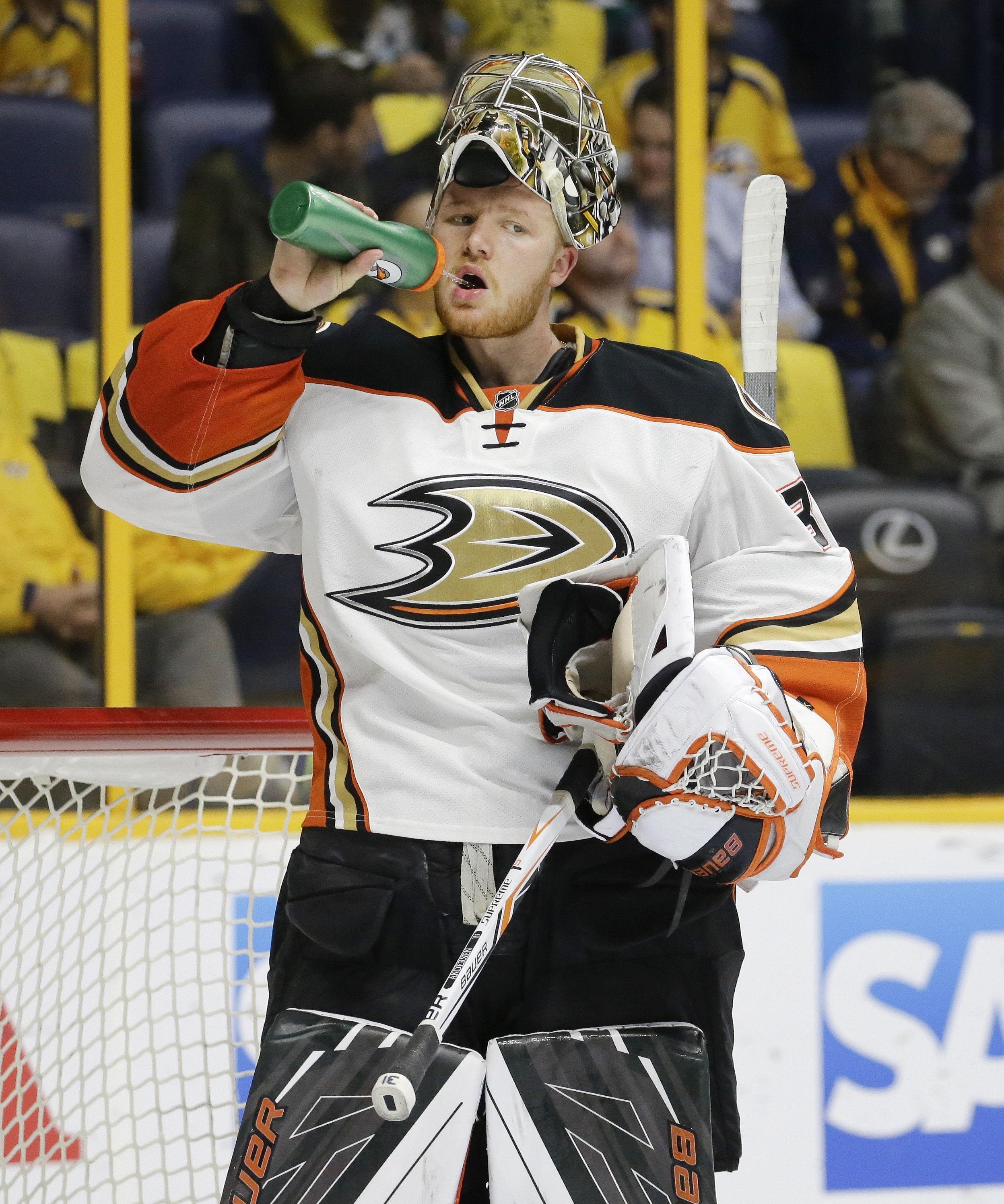 FILE - In this April 25, 2016 file photo, Anaheim Ducks goalie Frederik Andersen, of Denmark, takes a drink in the second period of Game 6 against the Nashville Predators in an NHL hockey first-round Stanley Cup playoff in Nashville, Tenn.  With the salar