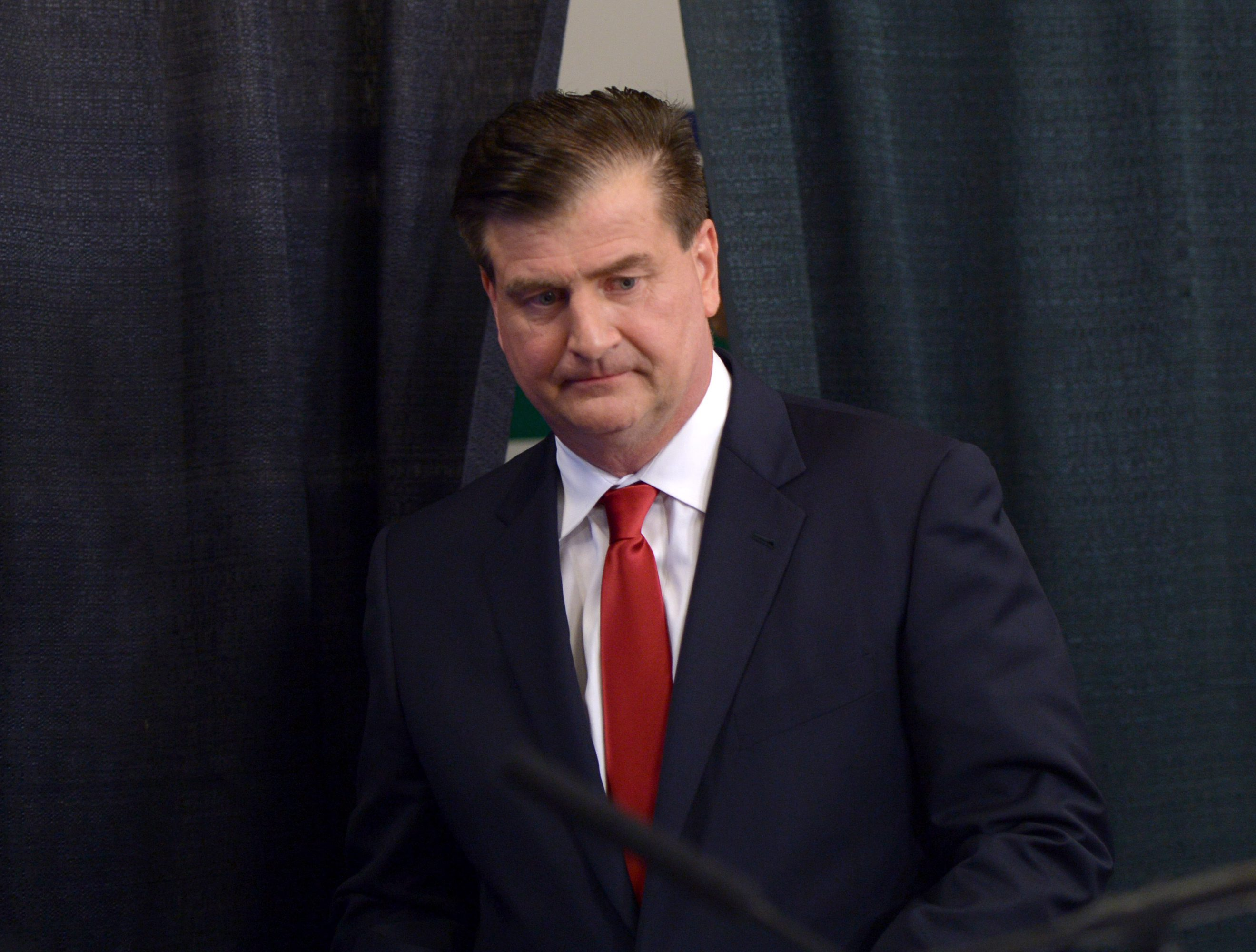 Jim Benning, new general manager of the Vancouver Canucks NHL hockey team, arrives at a news conference in Vancouver, Friday May 23, 2014. (AP Photo/The Canadian Press, Jonathan Hayward)