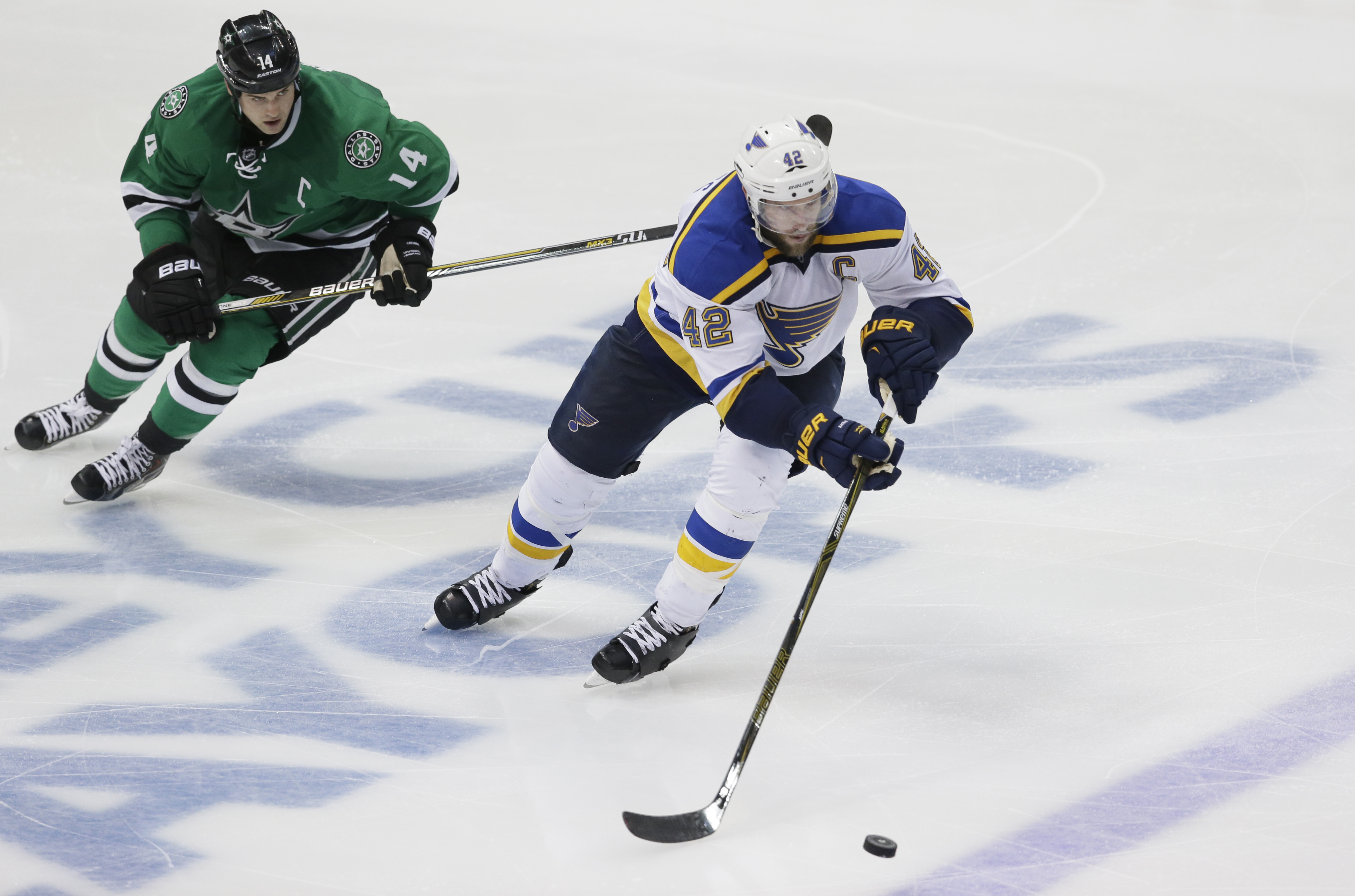 St. Louis Blues center David Backes (42) skates with the puck against Dallas Stars left wing Jamie Benn (14) during the third period of Game 7 of the NHL hockey Stanley Cup Western Conference semifinals Wednesday, May 11, 2016, in Dallas. The Blues won 6-