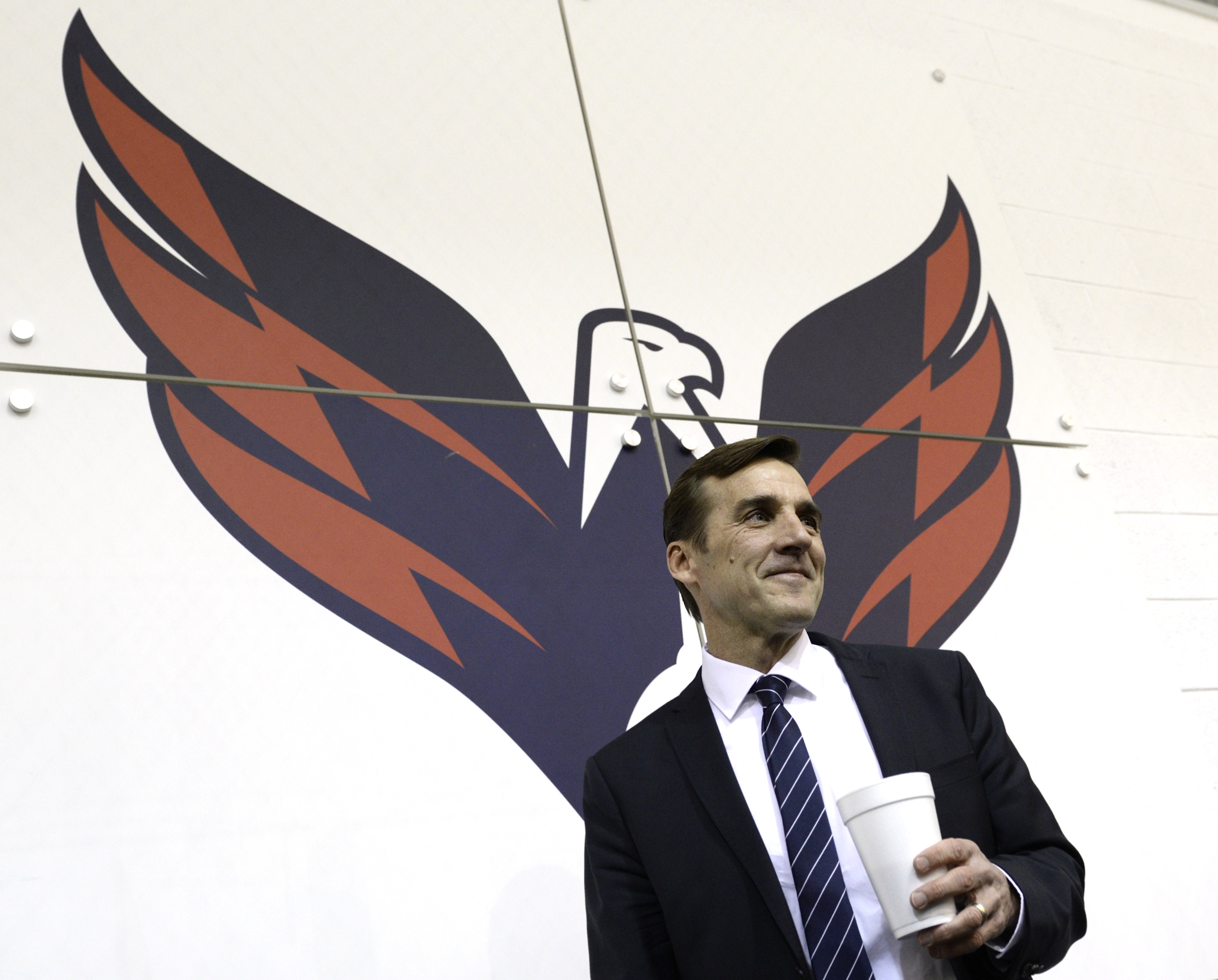 Washington Capitals former general manager George McPhee walks away from the podium after a news conference in Arlington, Va., Monday, April 28, 2014. McPhee and coach Adam Oates lost their jobs with the Washington Capitals after the team failed to make t