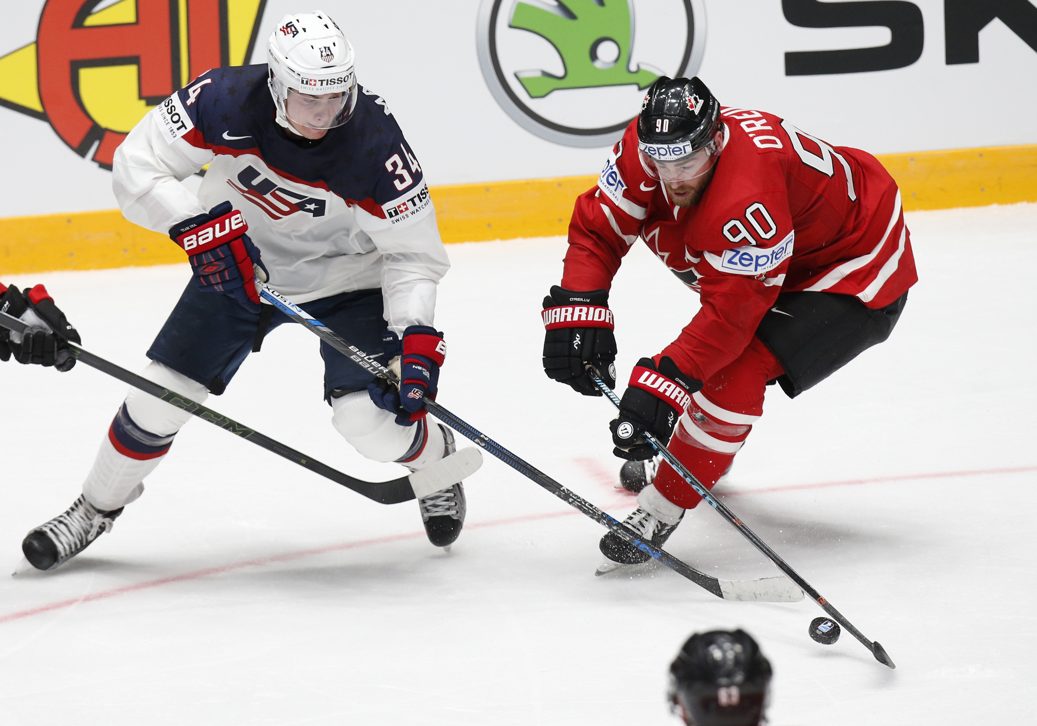 Auston Matthews of the United States, left, challenges Canadas Ryan Reilly during the Hockey World Championships Group B match in St. Petersburg, Russia, Friday, May 6, 2016. (AP Photo/Dmitri Lovetsky)